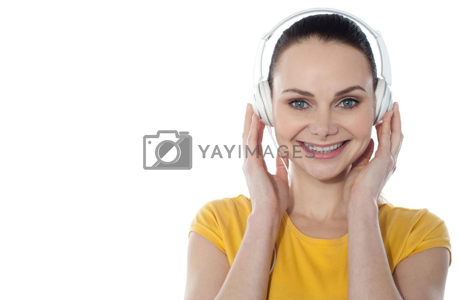Attractive teenager listening to music on her mp3 player