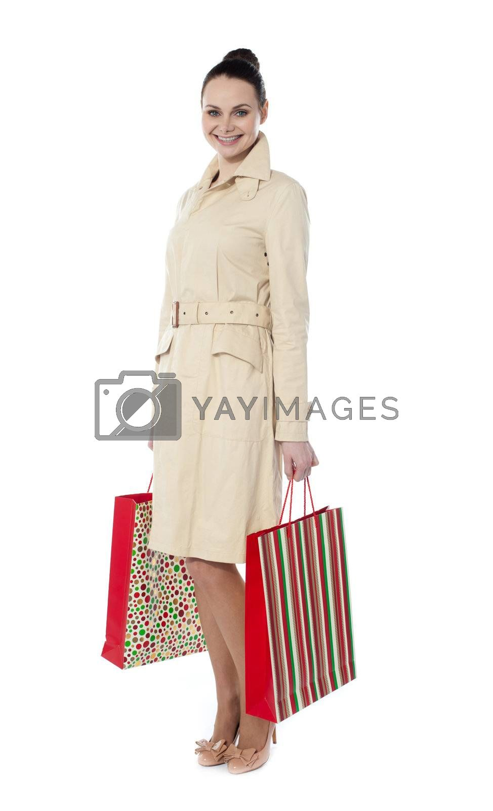 Portrait of a young woman with shopping bags in both hands