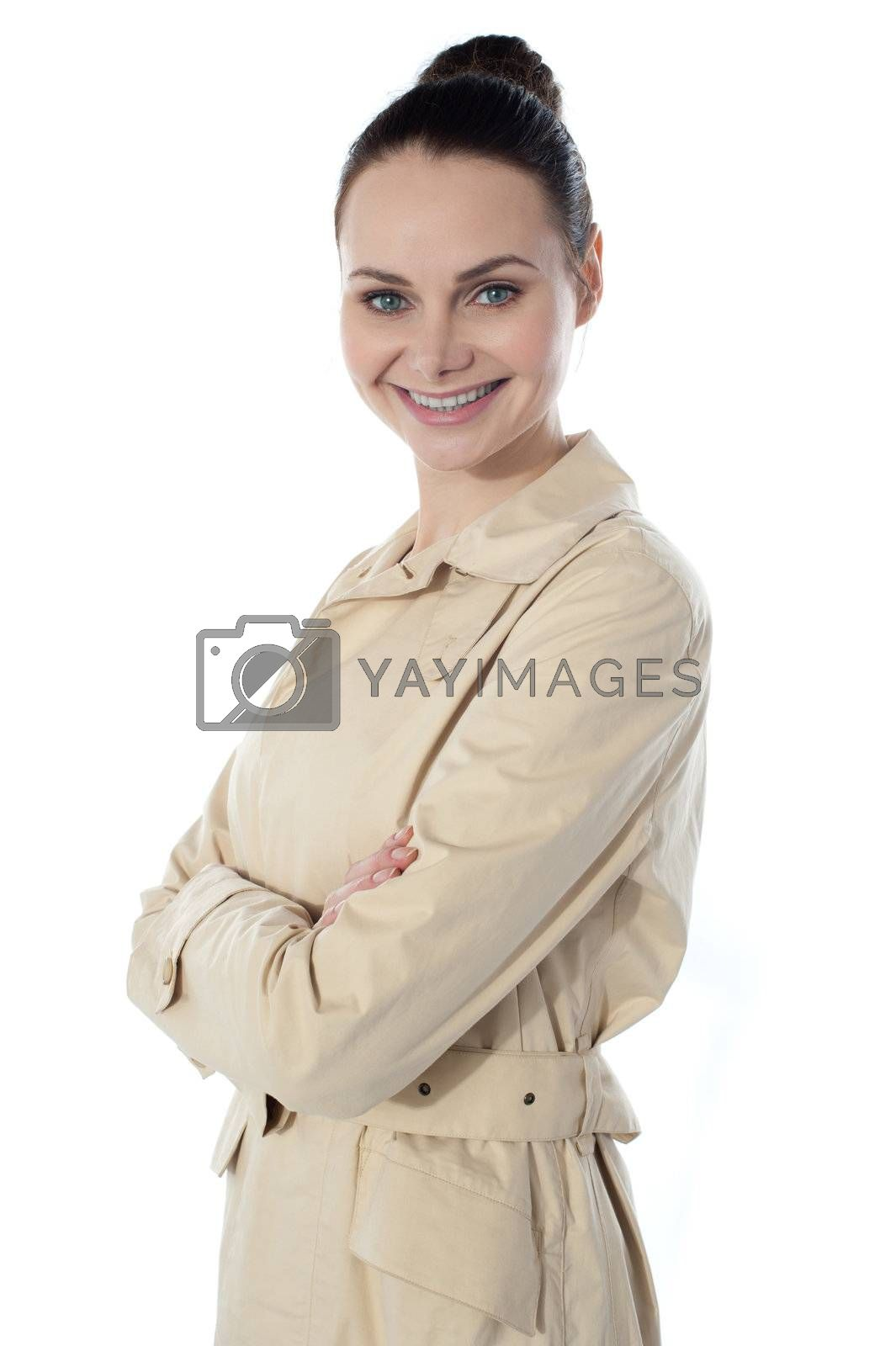 Fashionable glamor lady, smiling. Posing with folded arms