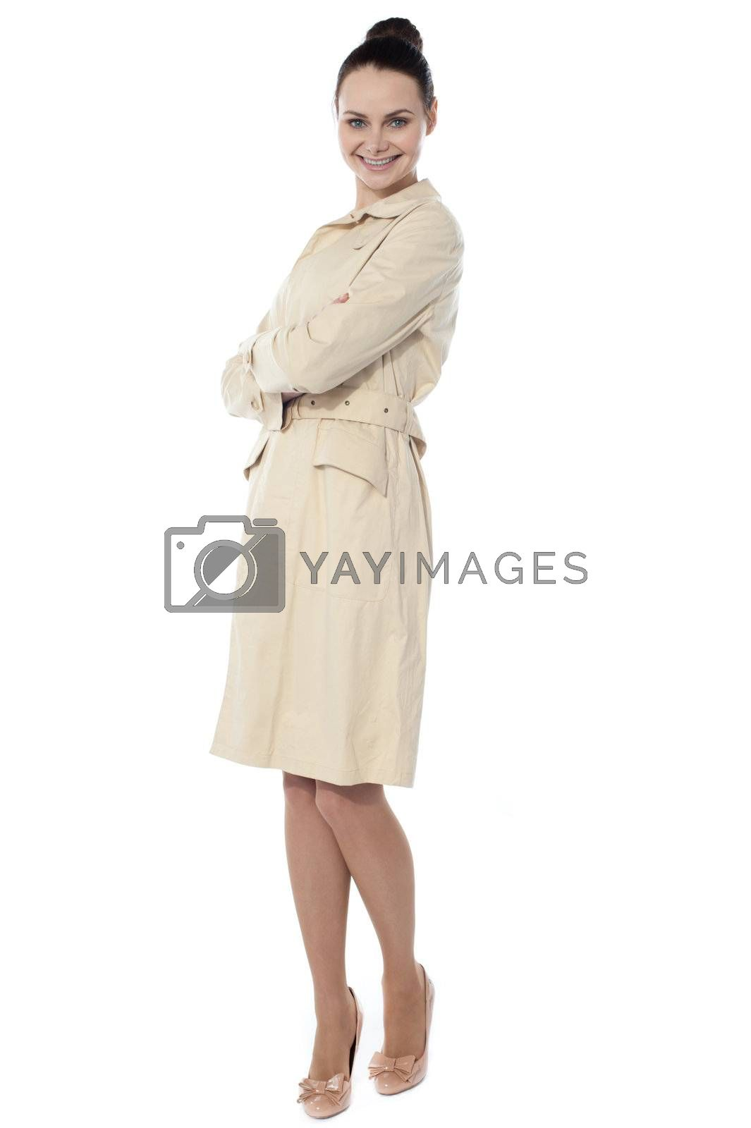 Smiling gorgeous woman posing with crossed arms against white background