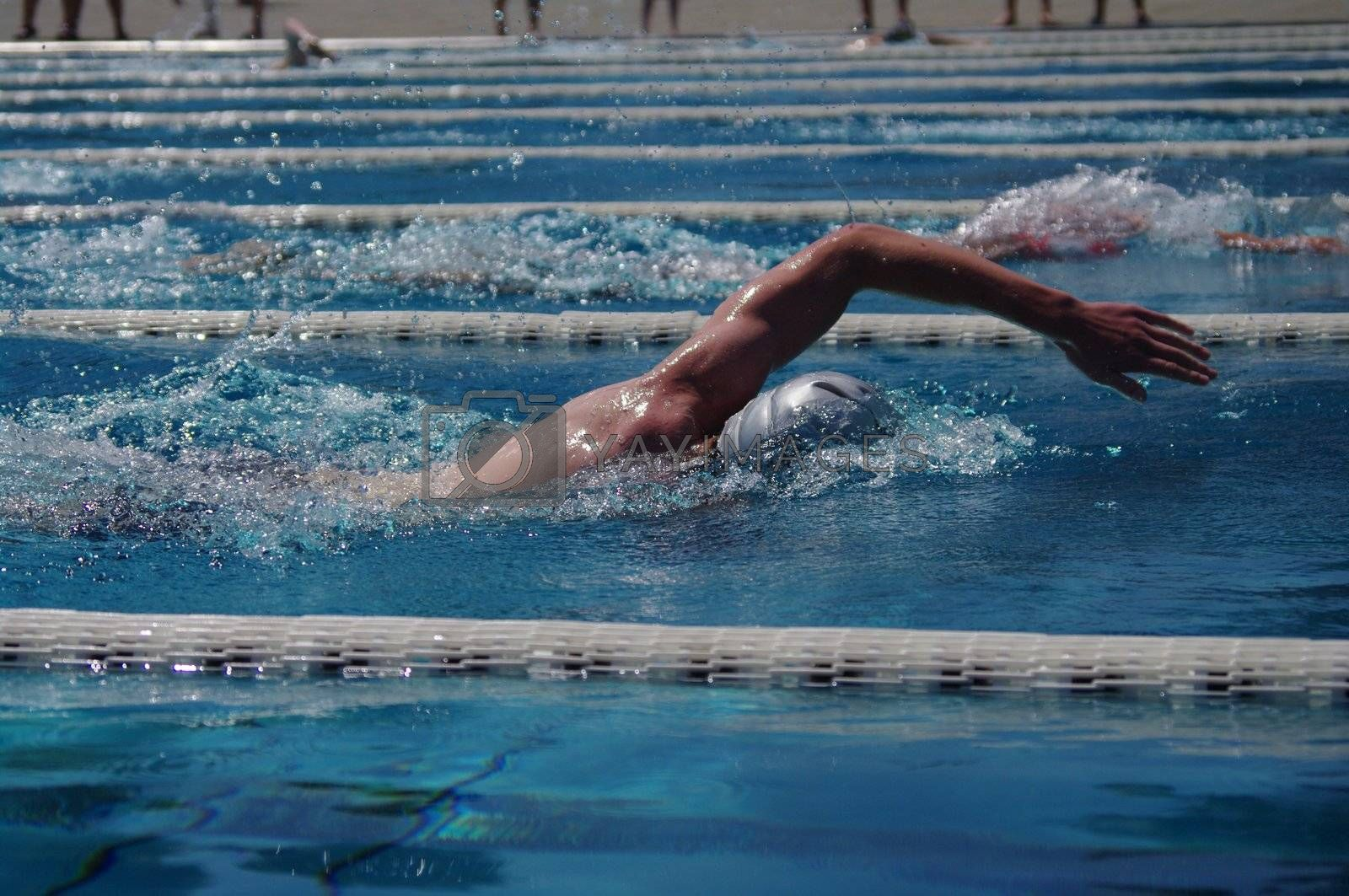 Freestyle swimmer in the outdoor swimming pool