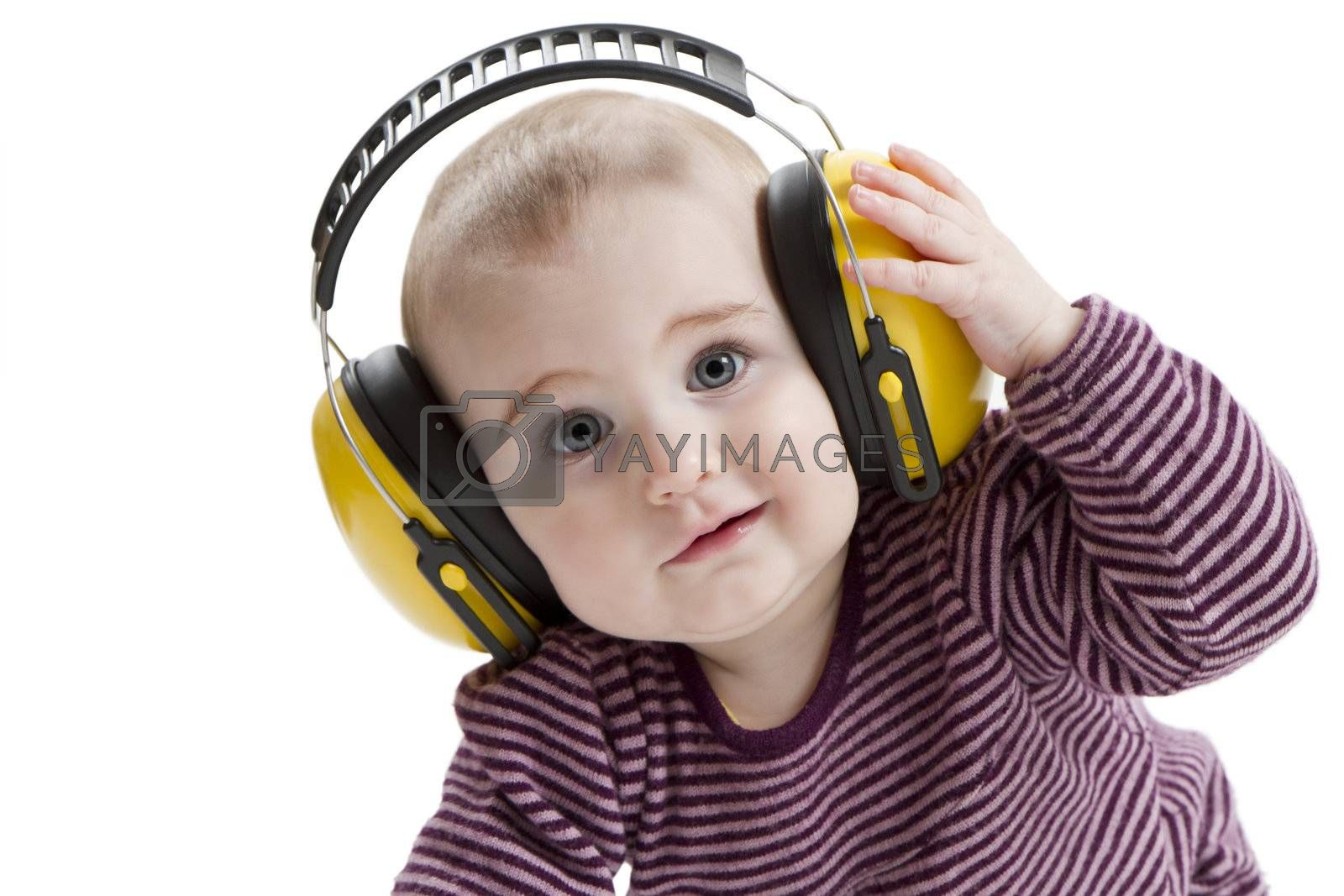young child with yellow ear protector. not amused