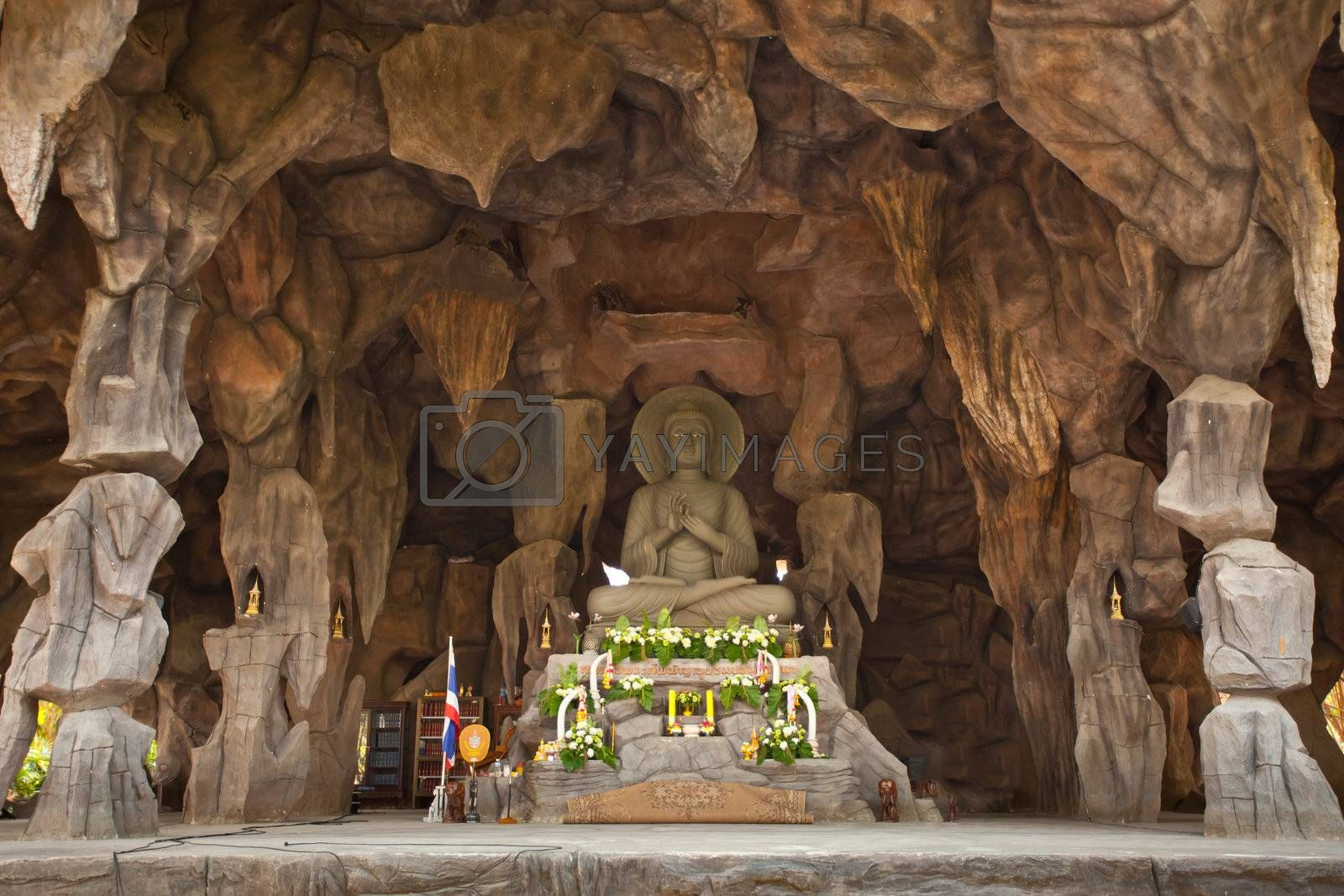 Image Buddha in cave by witthaya