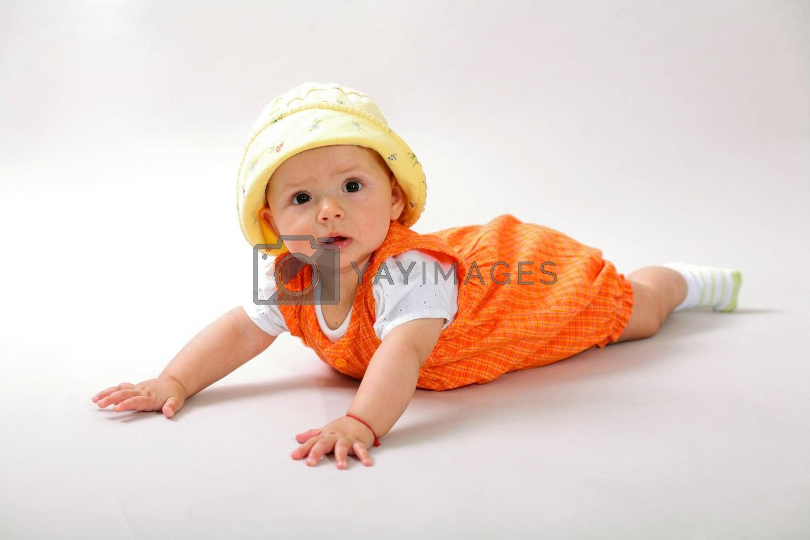 A nice baby-girl crawling on the floor