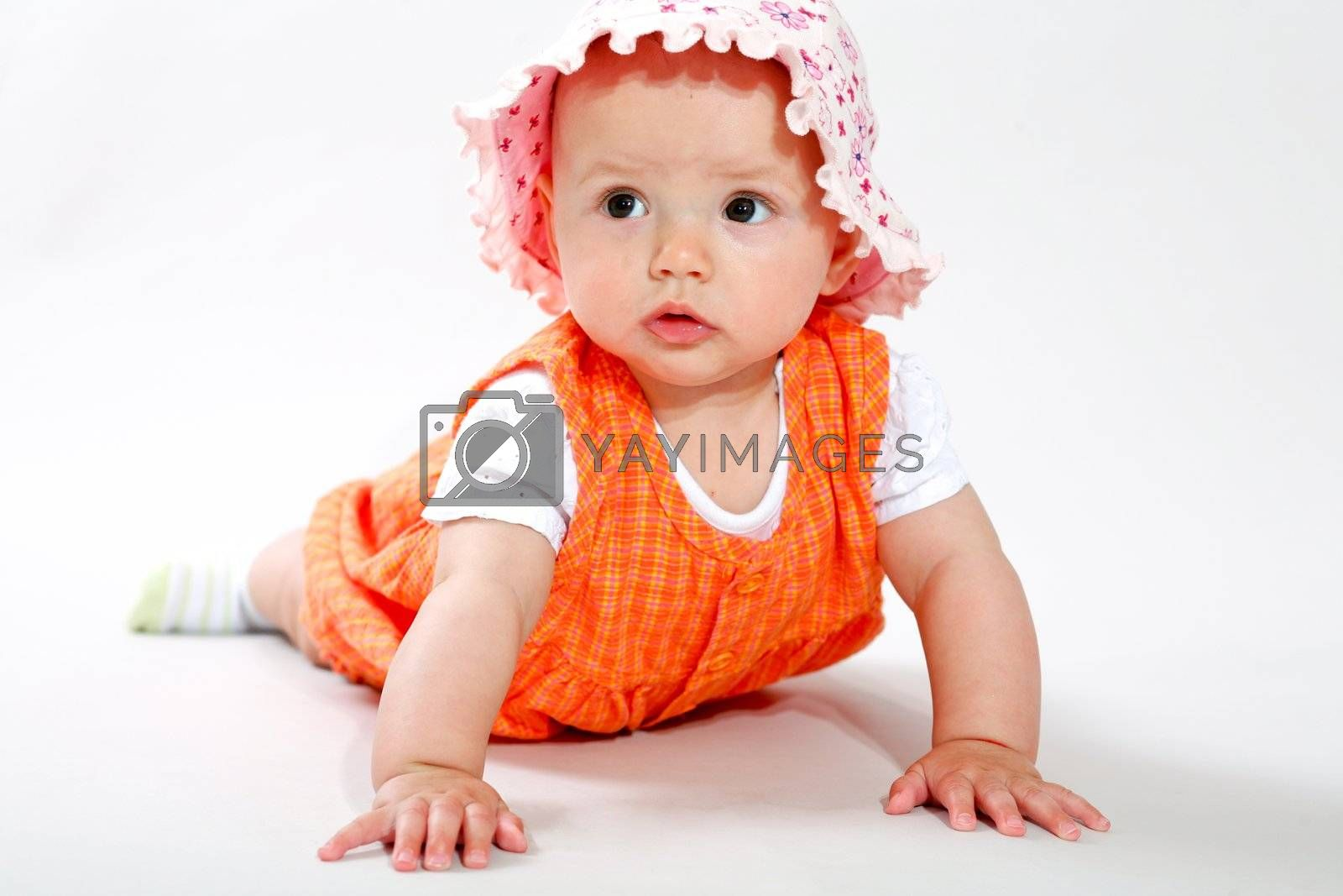 A little baby-girl crawling on the floor