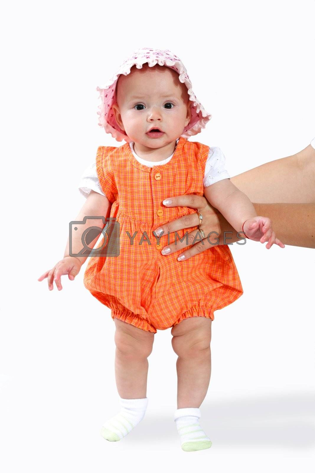 An image of nice baby in orange shirt