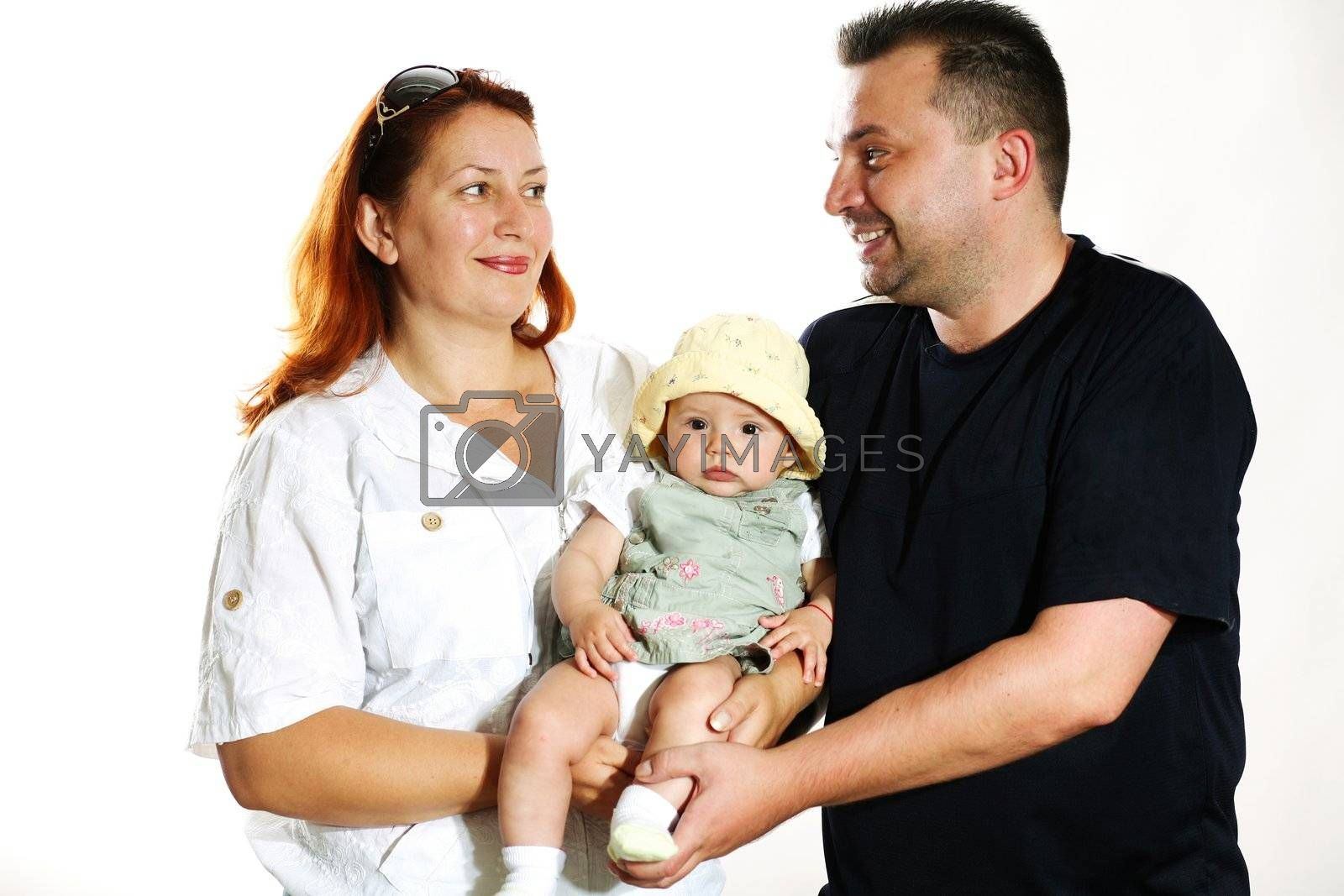 Family portrait in studio. Parents with a child.