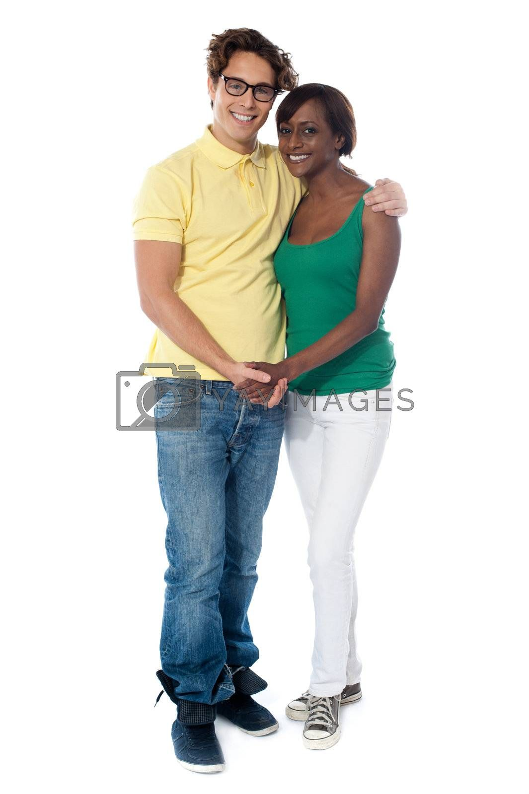 Couples hugging and holding hands standing over white background