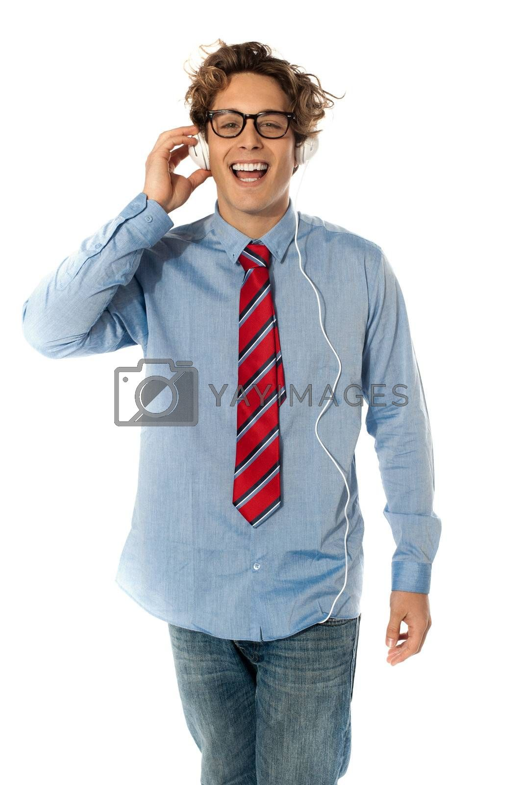 Young man listening to music isolated