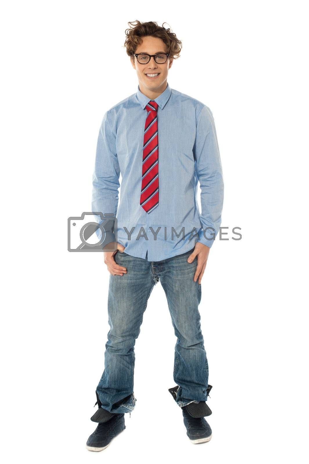 Handsome man standing casually with hands in pocket