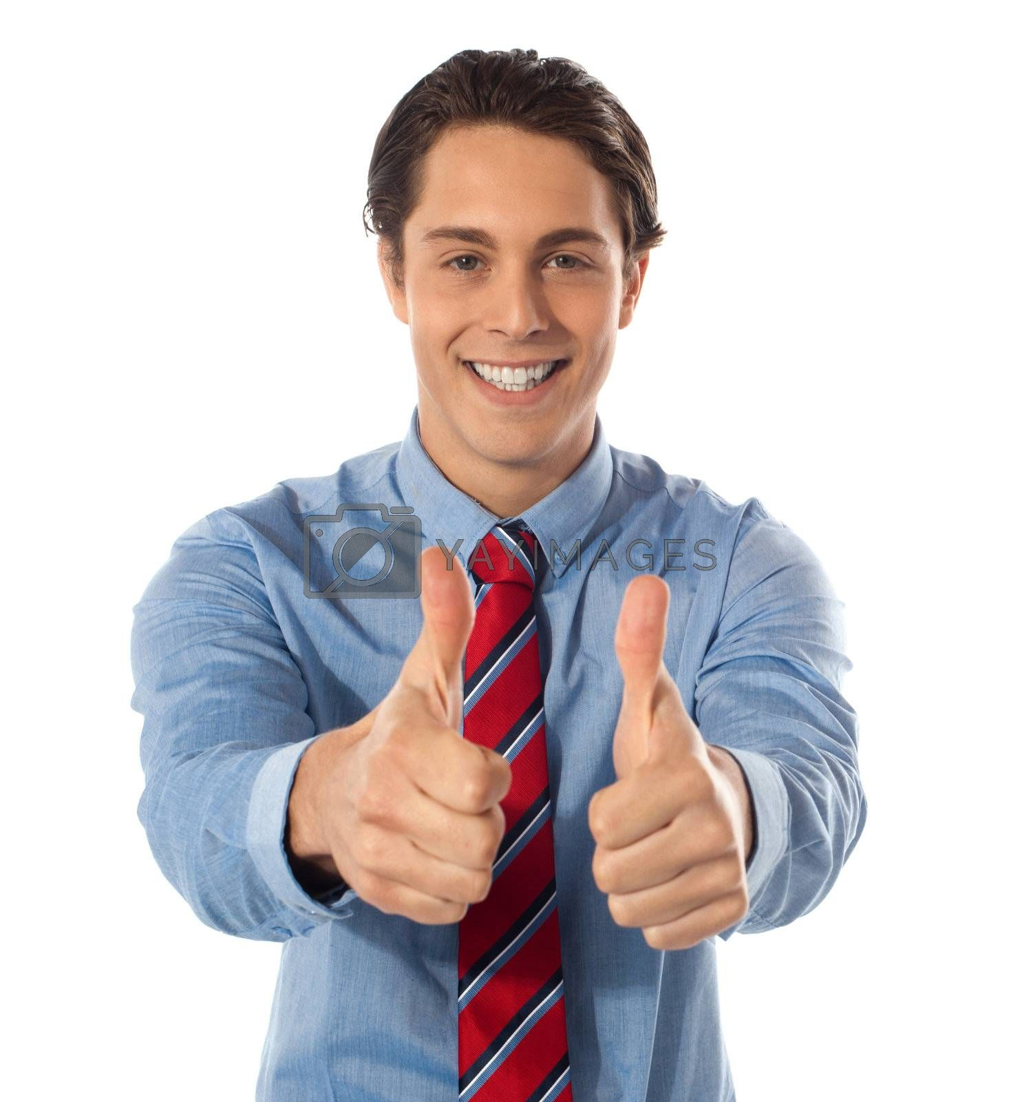 Handsome male executive gesturing thumbs-up
