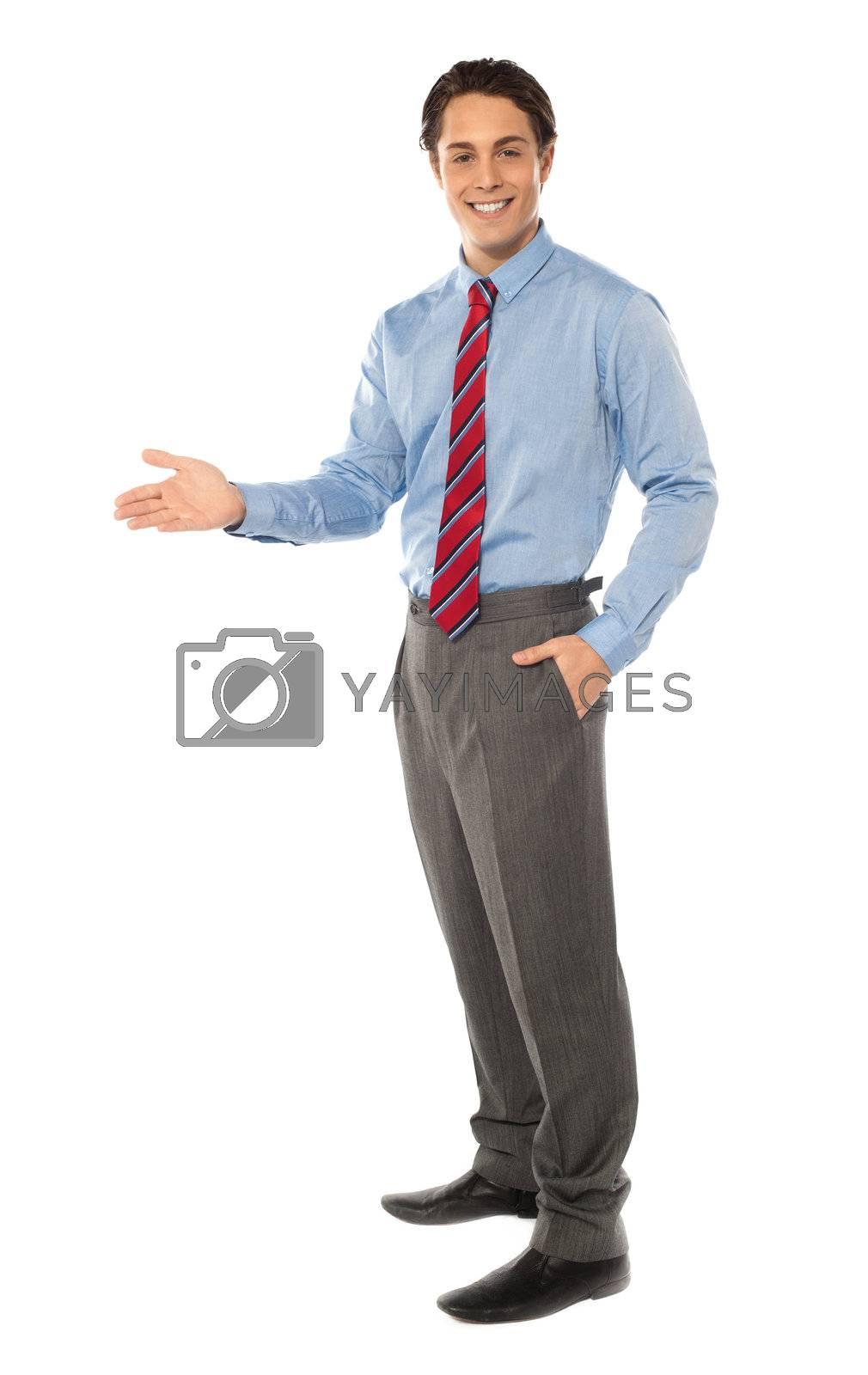 Stylish corporate gentleman posing, offering handshake