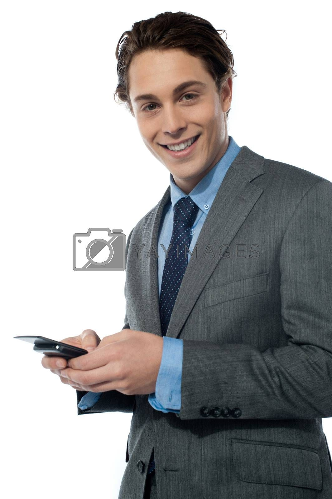 Handsome young man navigating on his smartphone isolated on white background