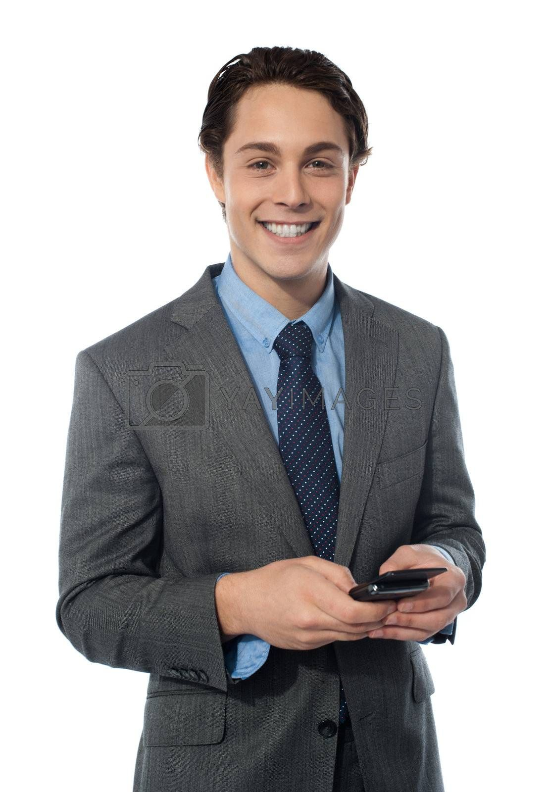 Handsome businessman using a smartphone isolated on white