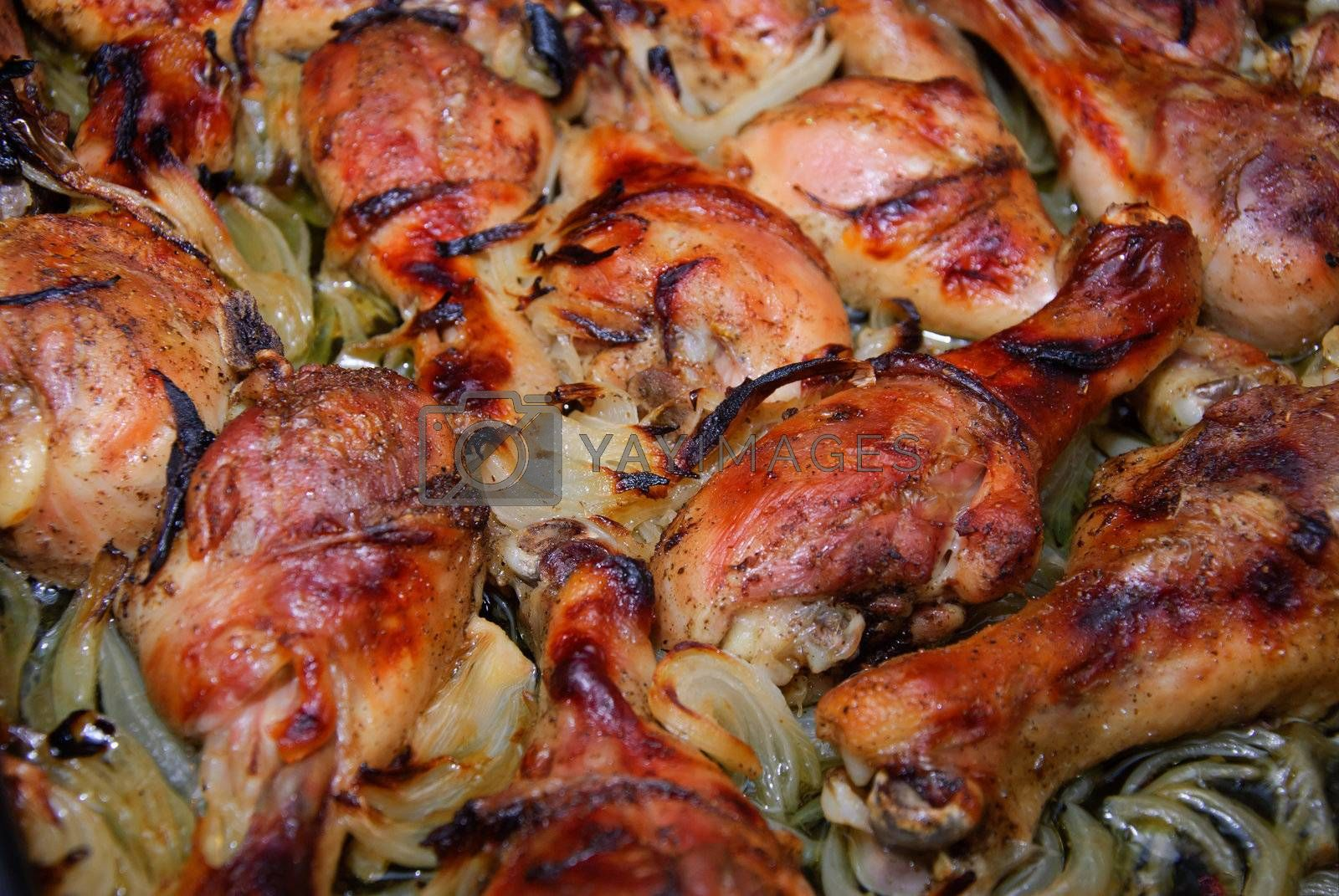 Fresh ripe roasted chicken legs on barbecue pan