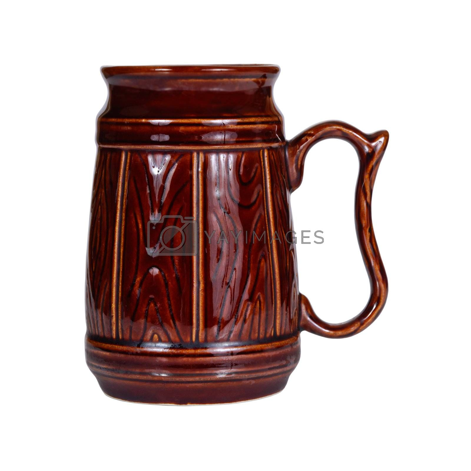 Big traditional brown ceramic mug for beer isolated on white background