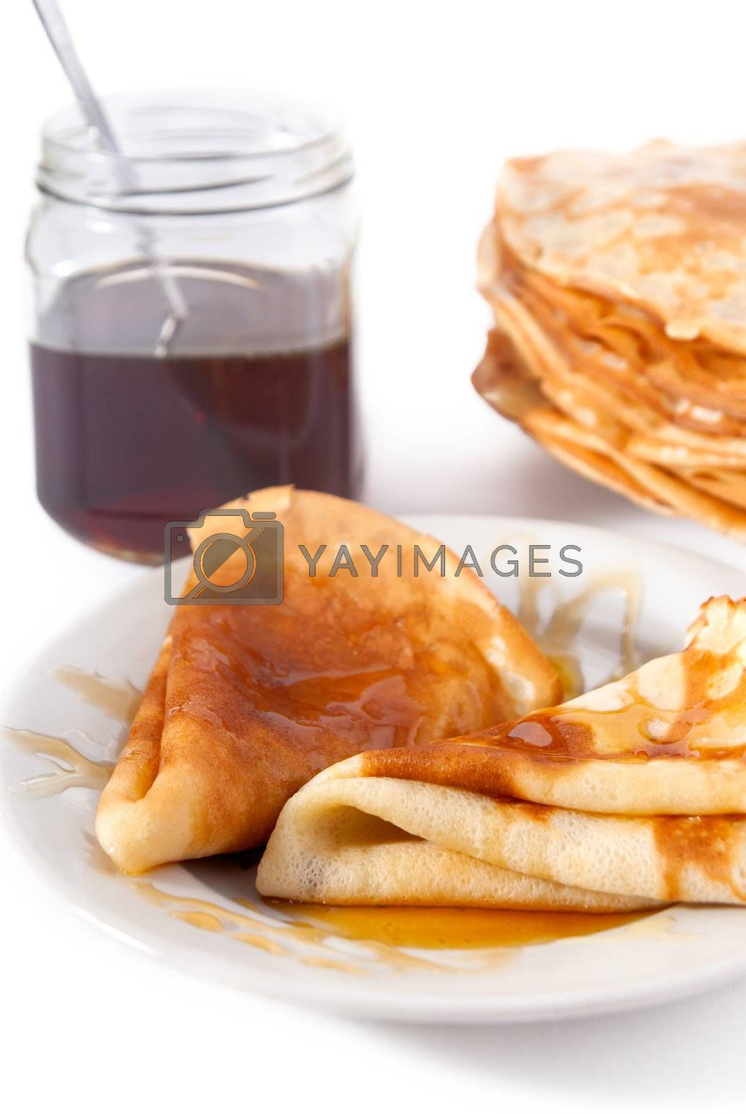 Russian pancake with honey on white