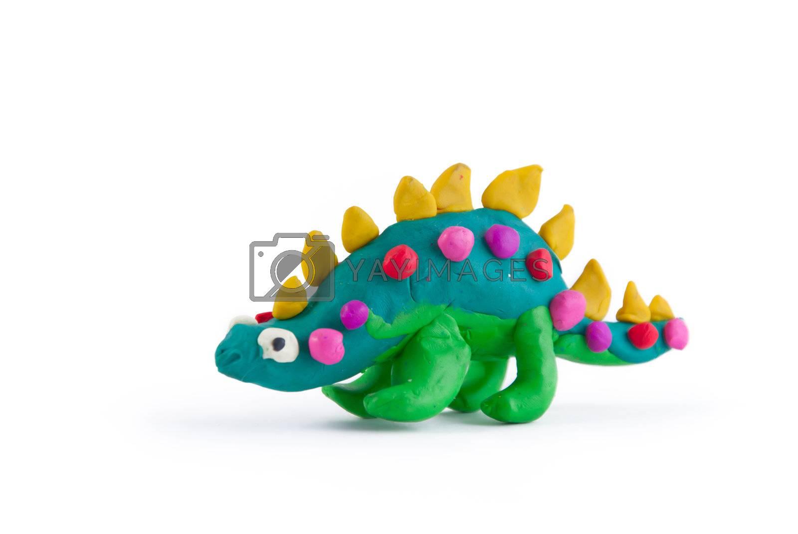 Dinosaur made of plasticine isolated on white