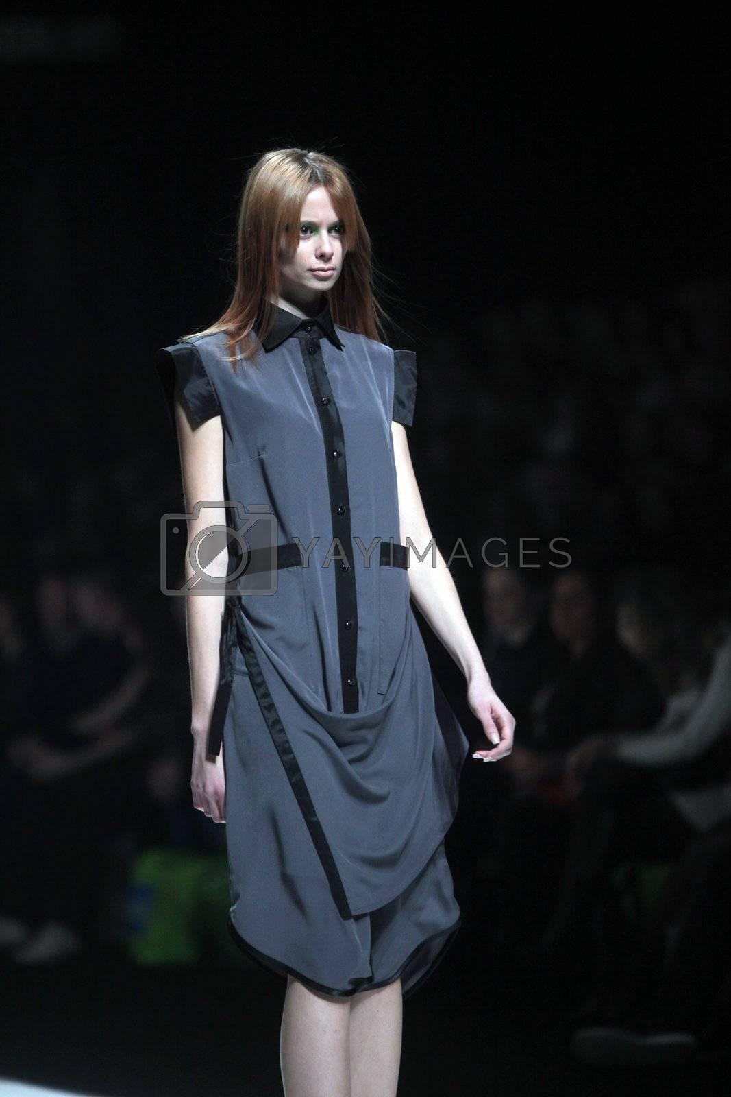 "ZAGREB, CROATIA - MARCH 16: Fashion model wears clothes made by Ana Maria Ricov on ""Dove FASHION.HR"" show on March 16, 2012 in Zagreb, Croatia."