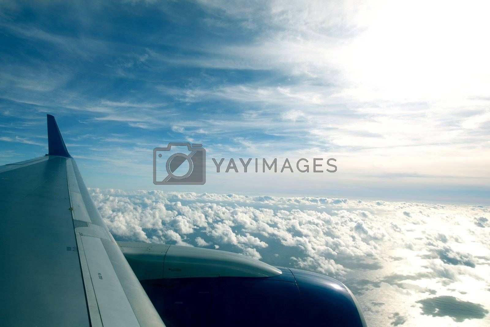 airplane fly in blue sky cloud around
