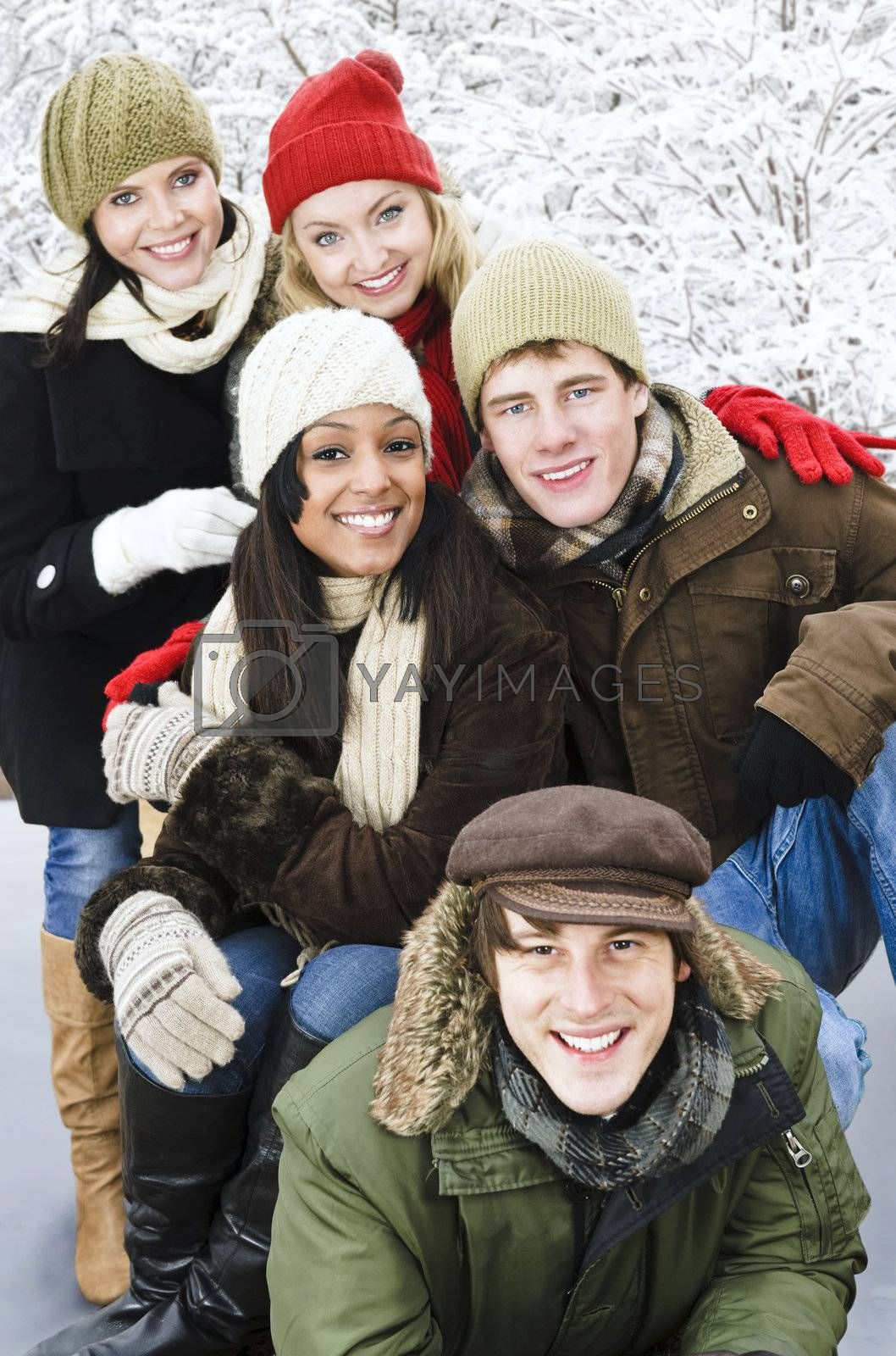 Group of friends outside in winter by elenathewise