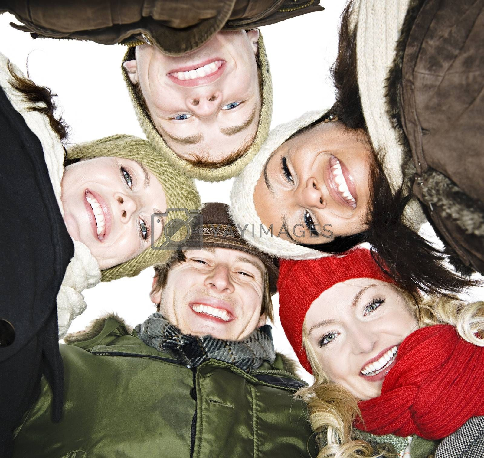 Faces of happy diverse young friends from below