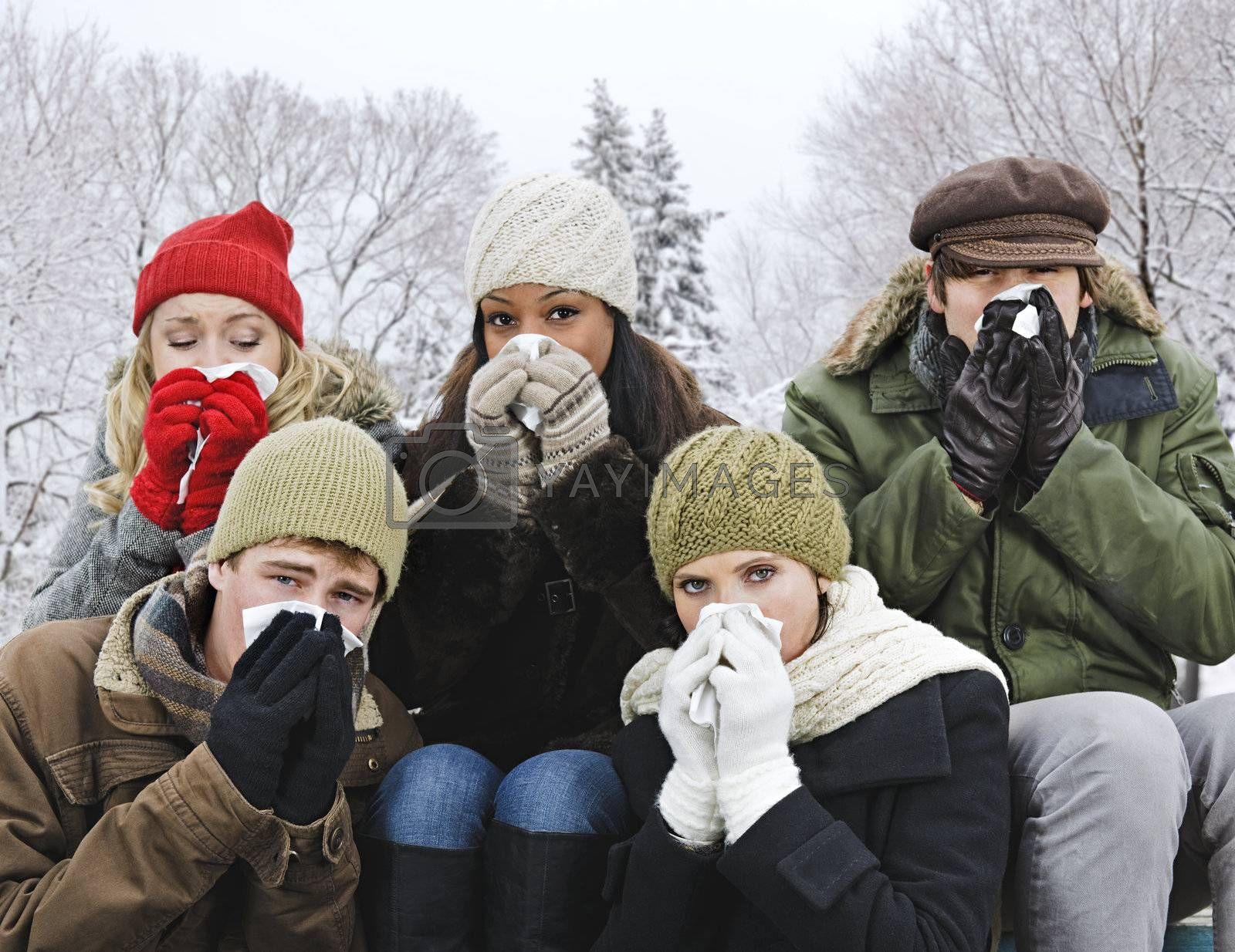Group of friends with colds outside in winter by elenathewise