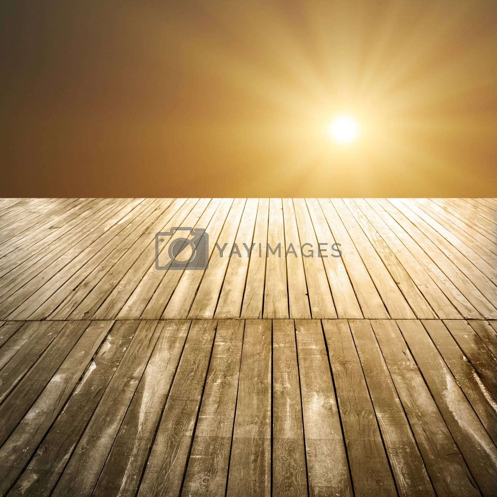sunset or sunrise on a wooden pier