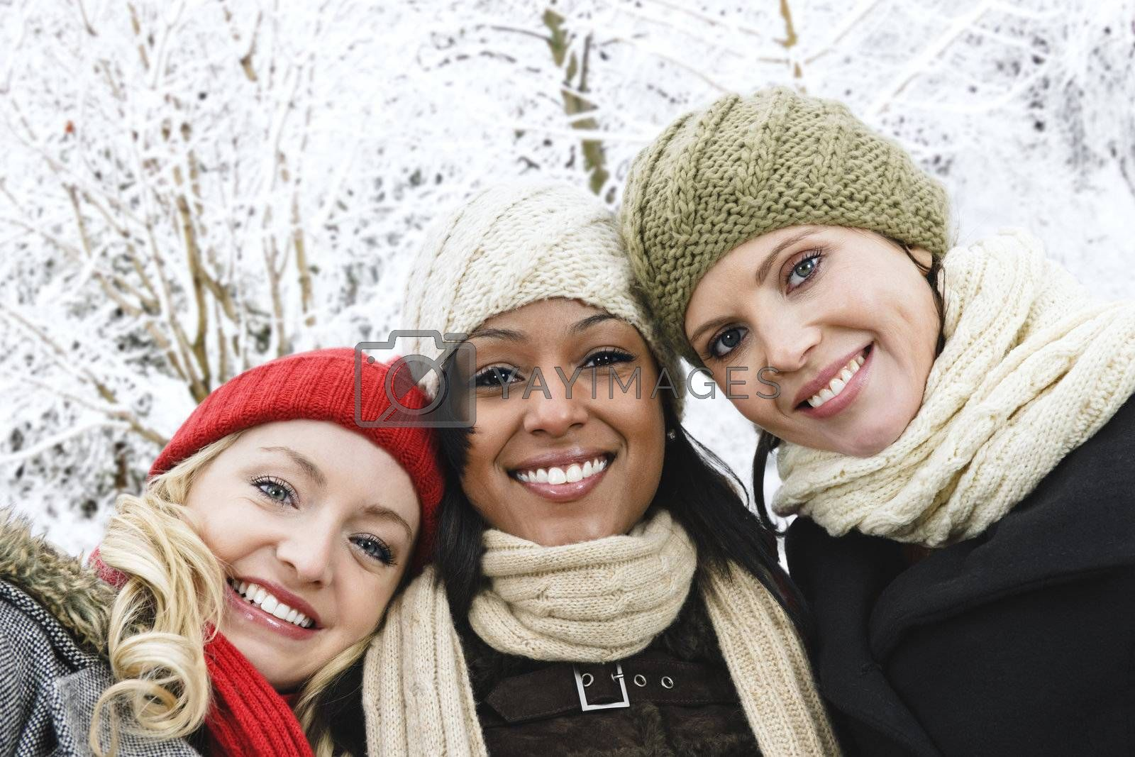 Group of girl friends outside in winter by elenathewise