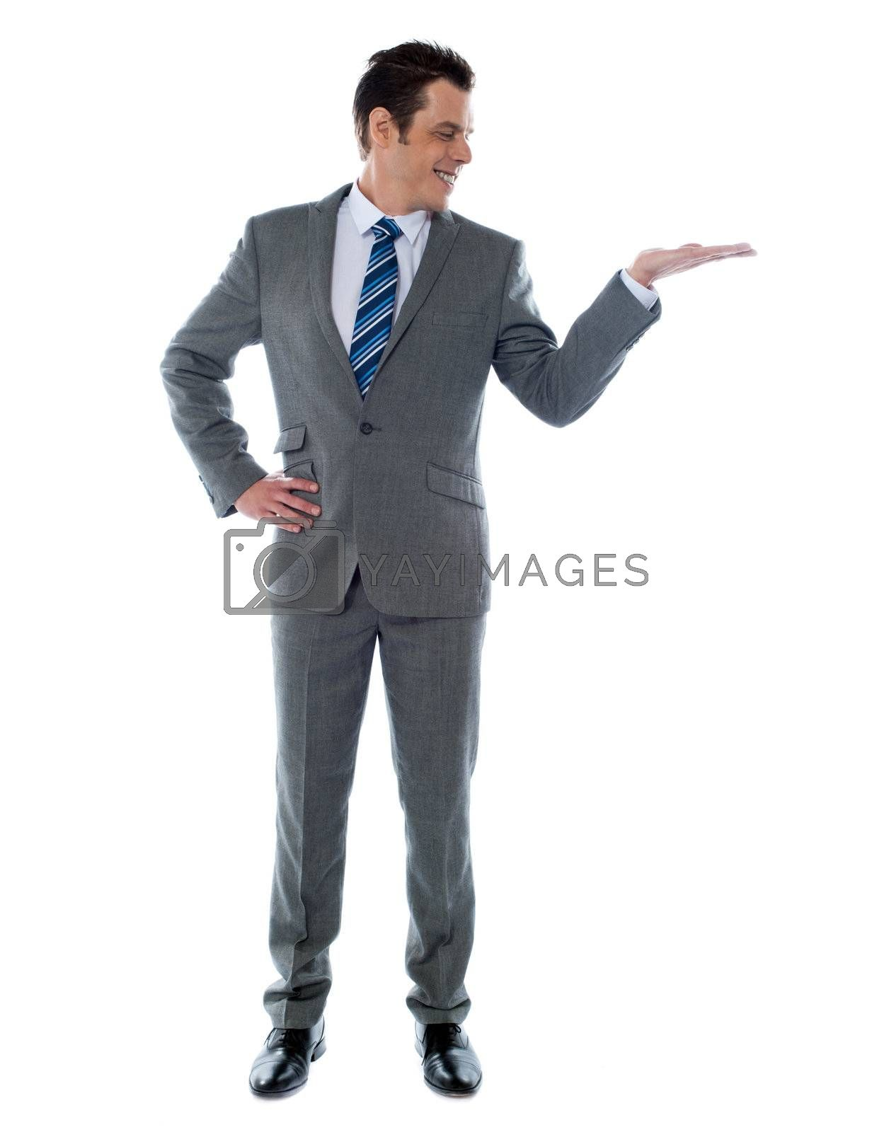 Happy businessman giving presentation on white background