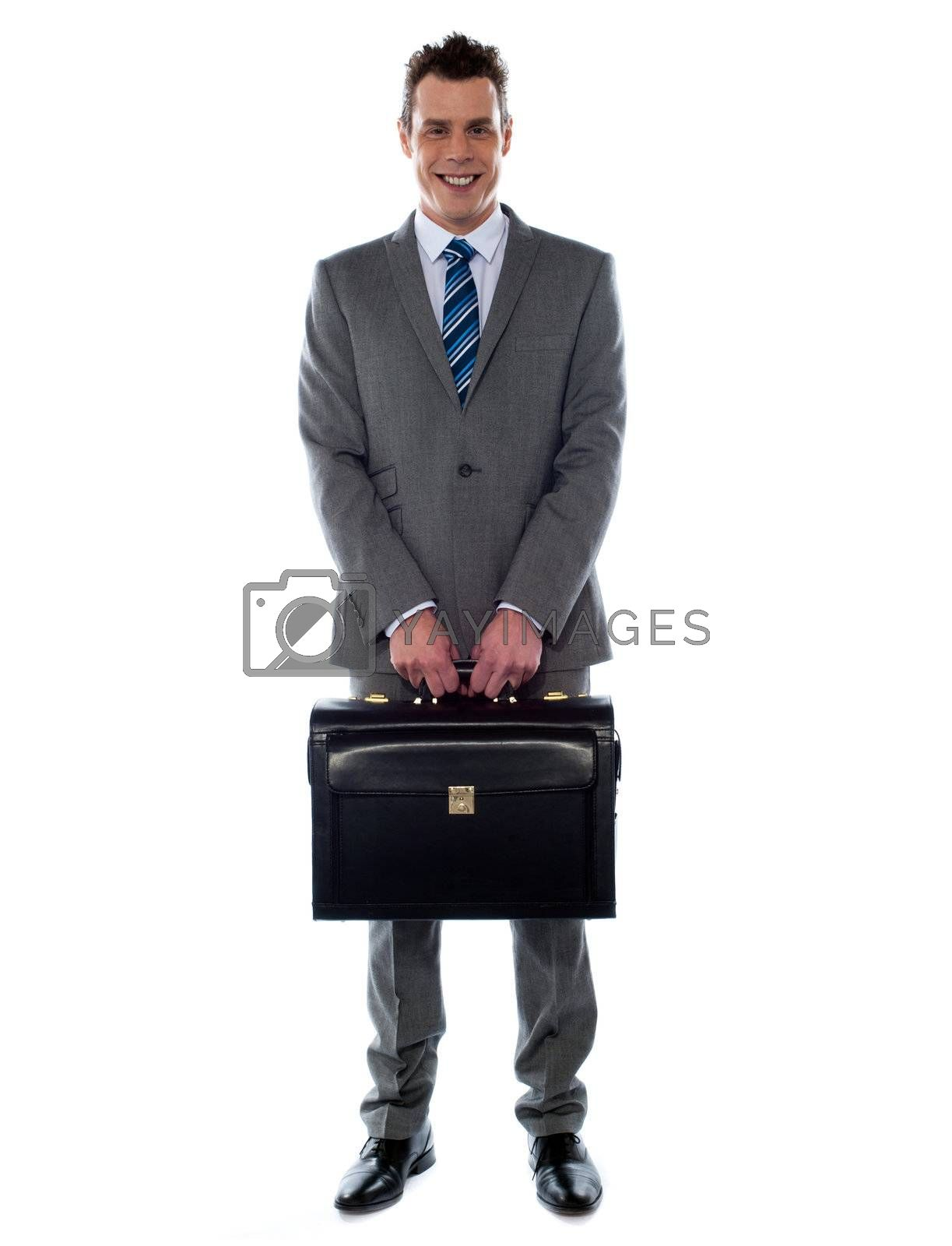 Comany's CEO holding his handbag in front of camera