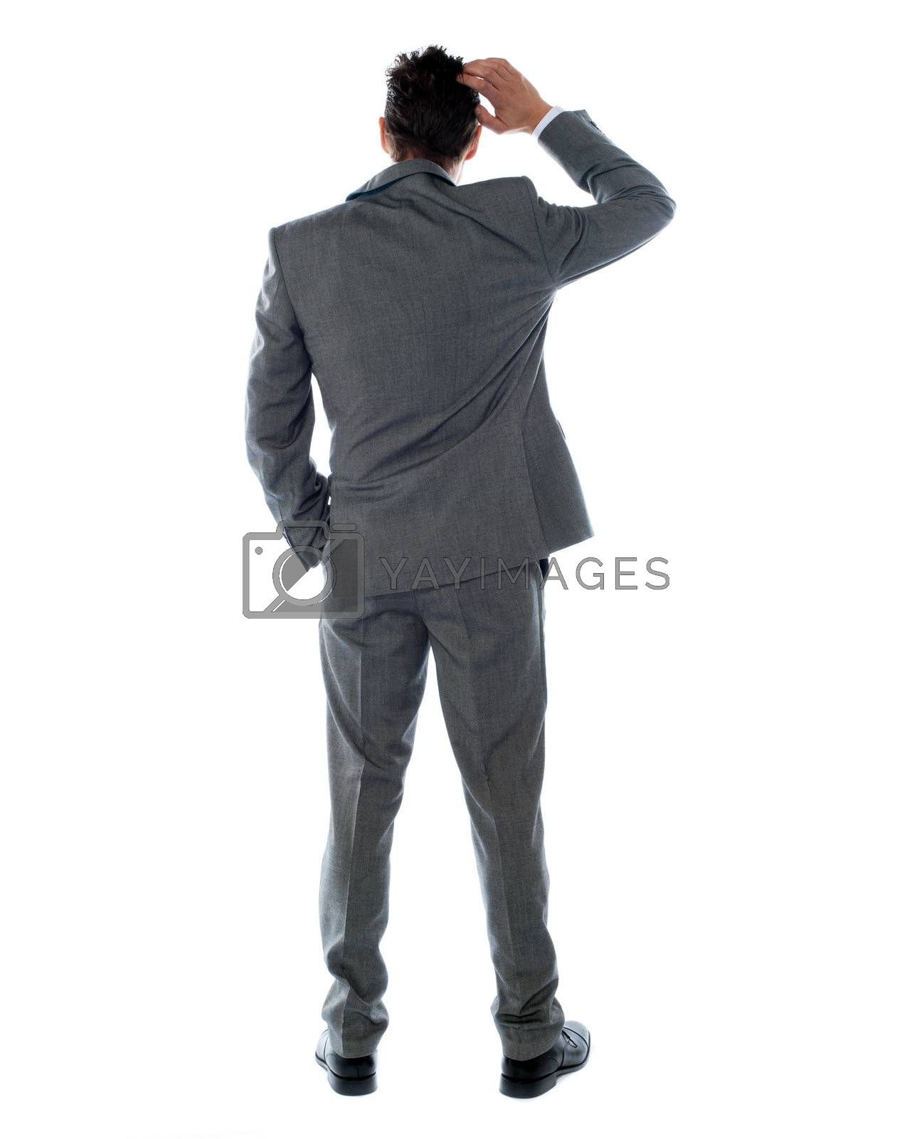 Back-pose of a corporate person thinking. Isolated over white background
