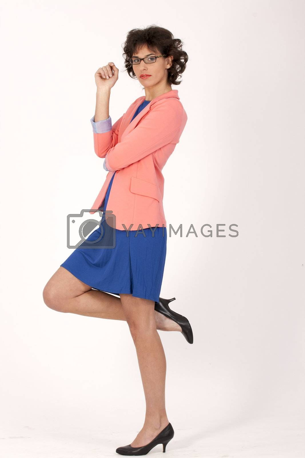Fashionable woman with glasses in a business suit