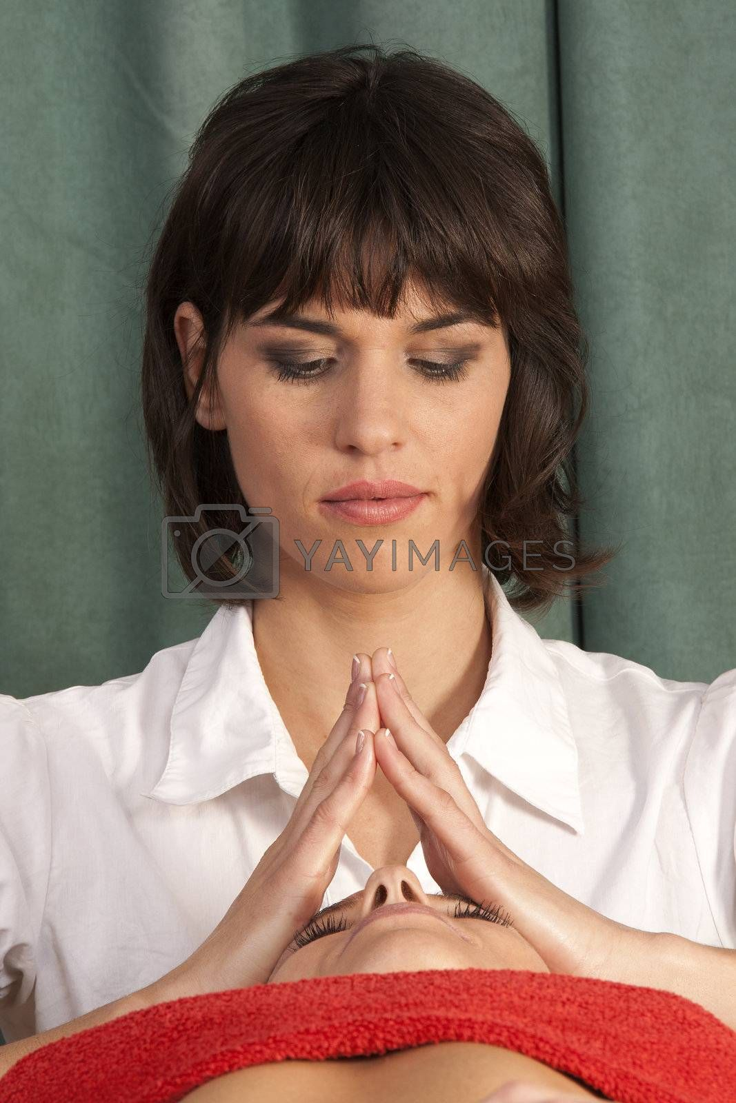Young woman is treated with meditation