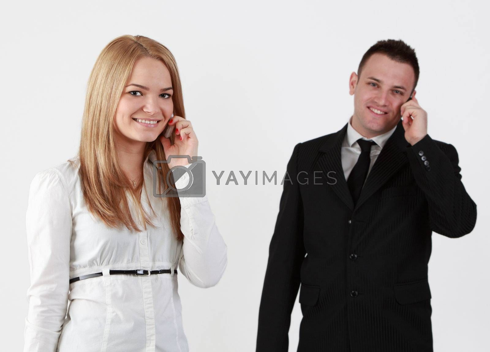 Young couple using mobile phones.Selective focus on the blonde woman.