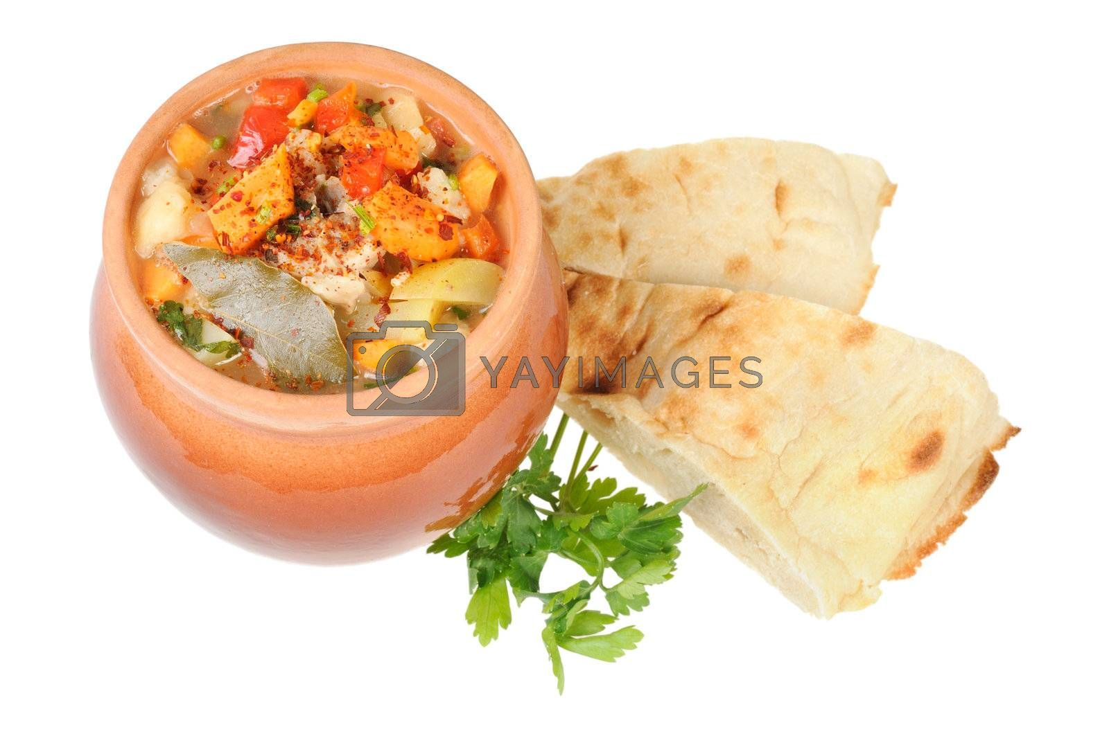 Roast in a pot and pita bread. Isolated on white.