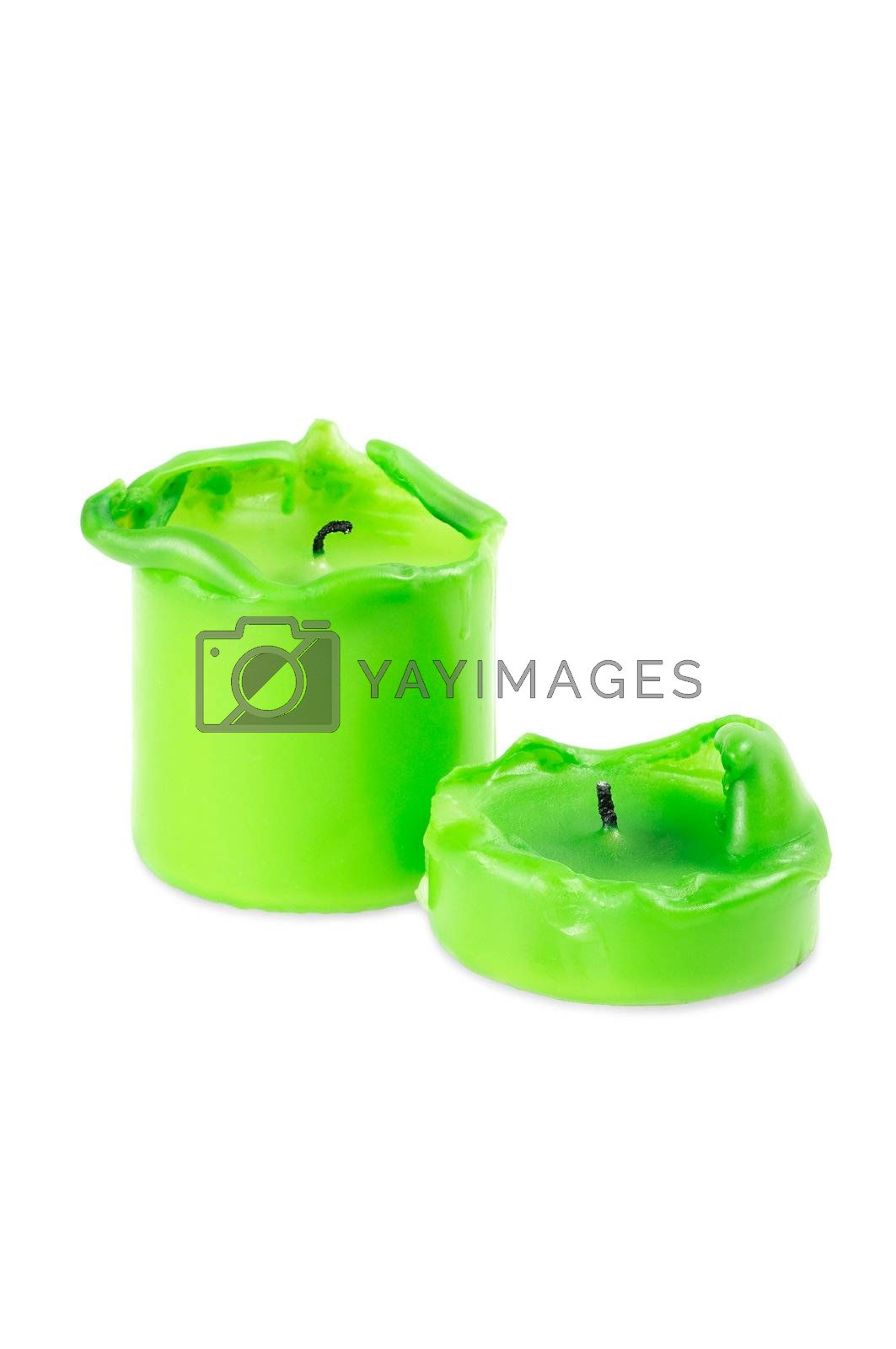 Two green big  melting  candle. Isolated on white