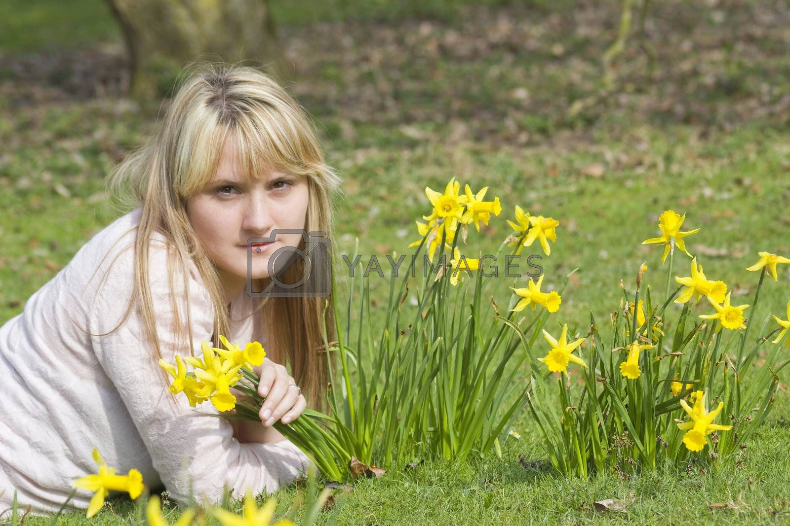 beautiful young woman with flowers on a warm spring day