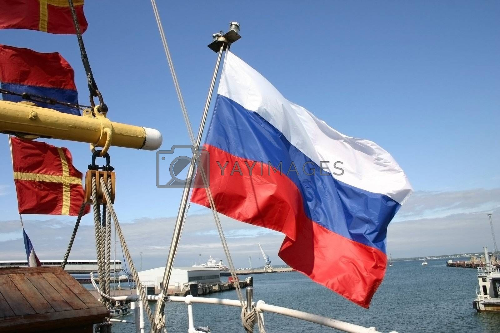 Russian flag of a sailing vessel against the sea in port