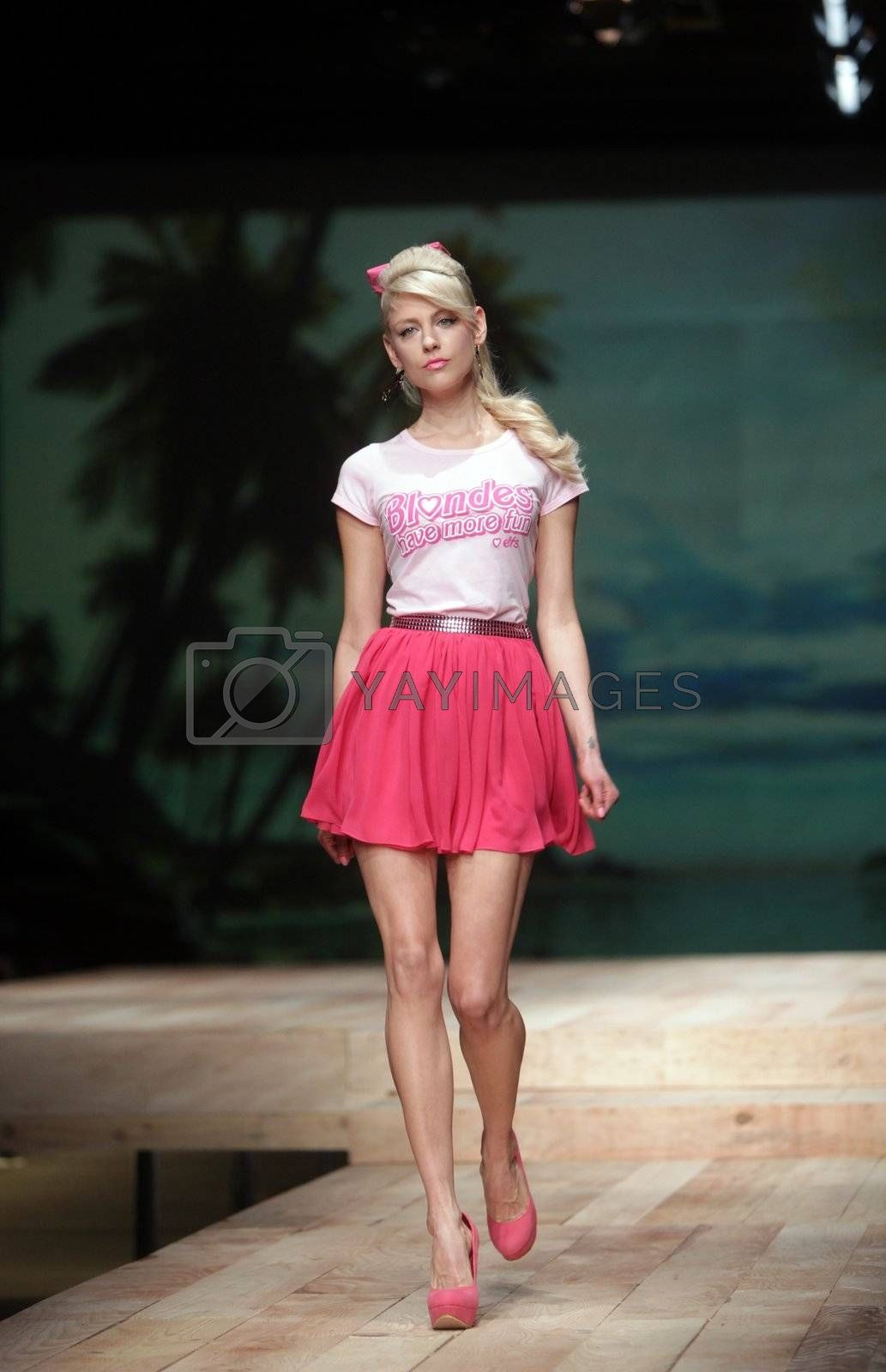 """ZAGREB, CROATIA - MARCH 23: Fashion model wears clothes made by ELFS on """"CRO A PORTER"""" show on March 23, 2012 in Zagreb, Croatia."""