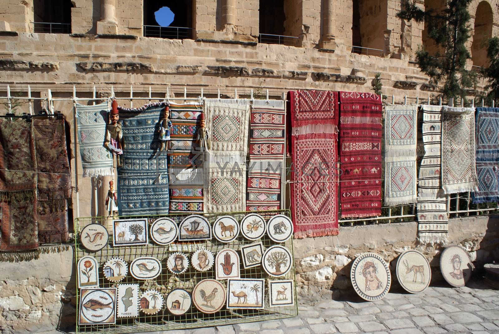 Souvenirs near the wall of roman theater in El-Jem, Tunisia