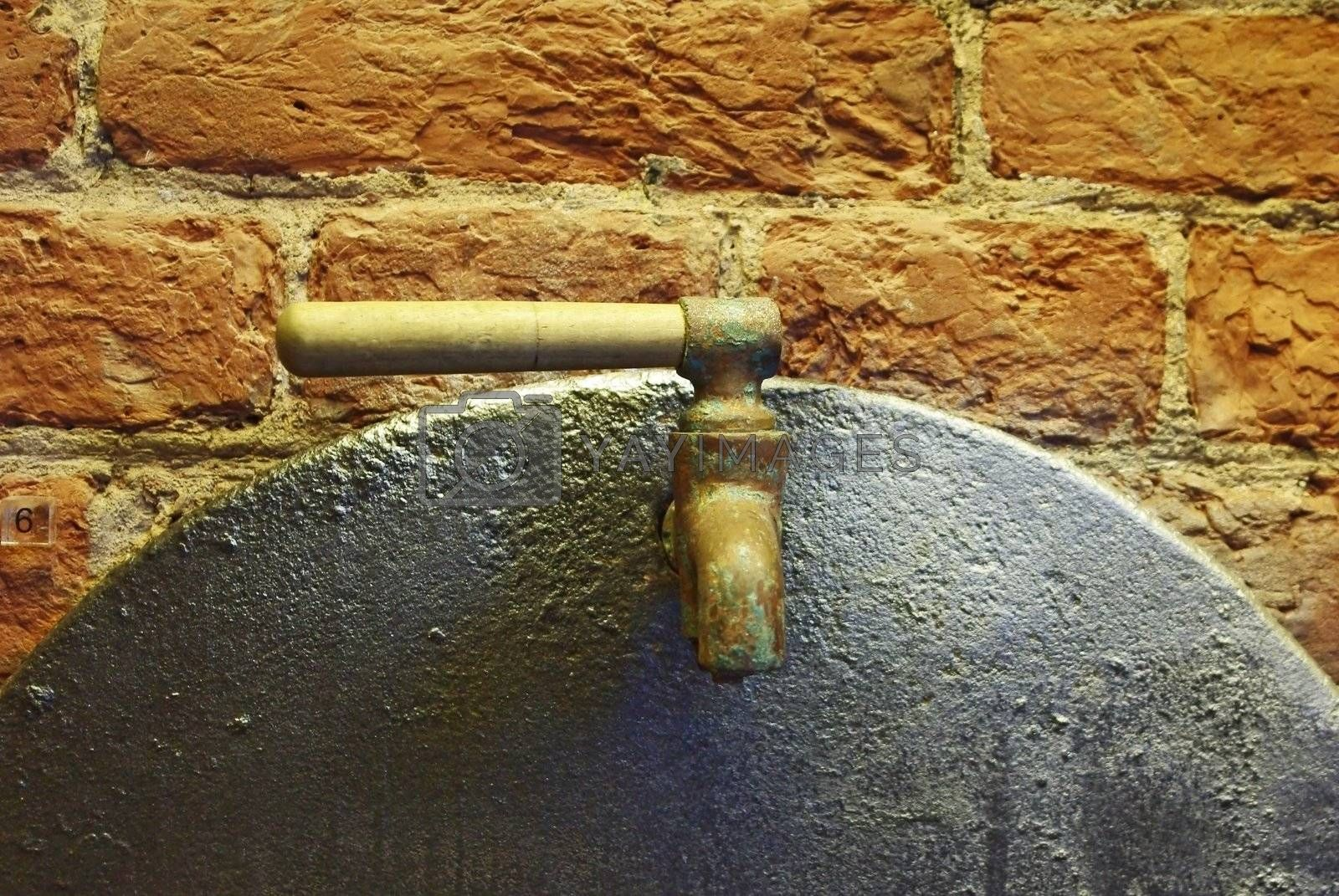 Close up of old water tap over brick wall