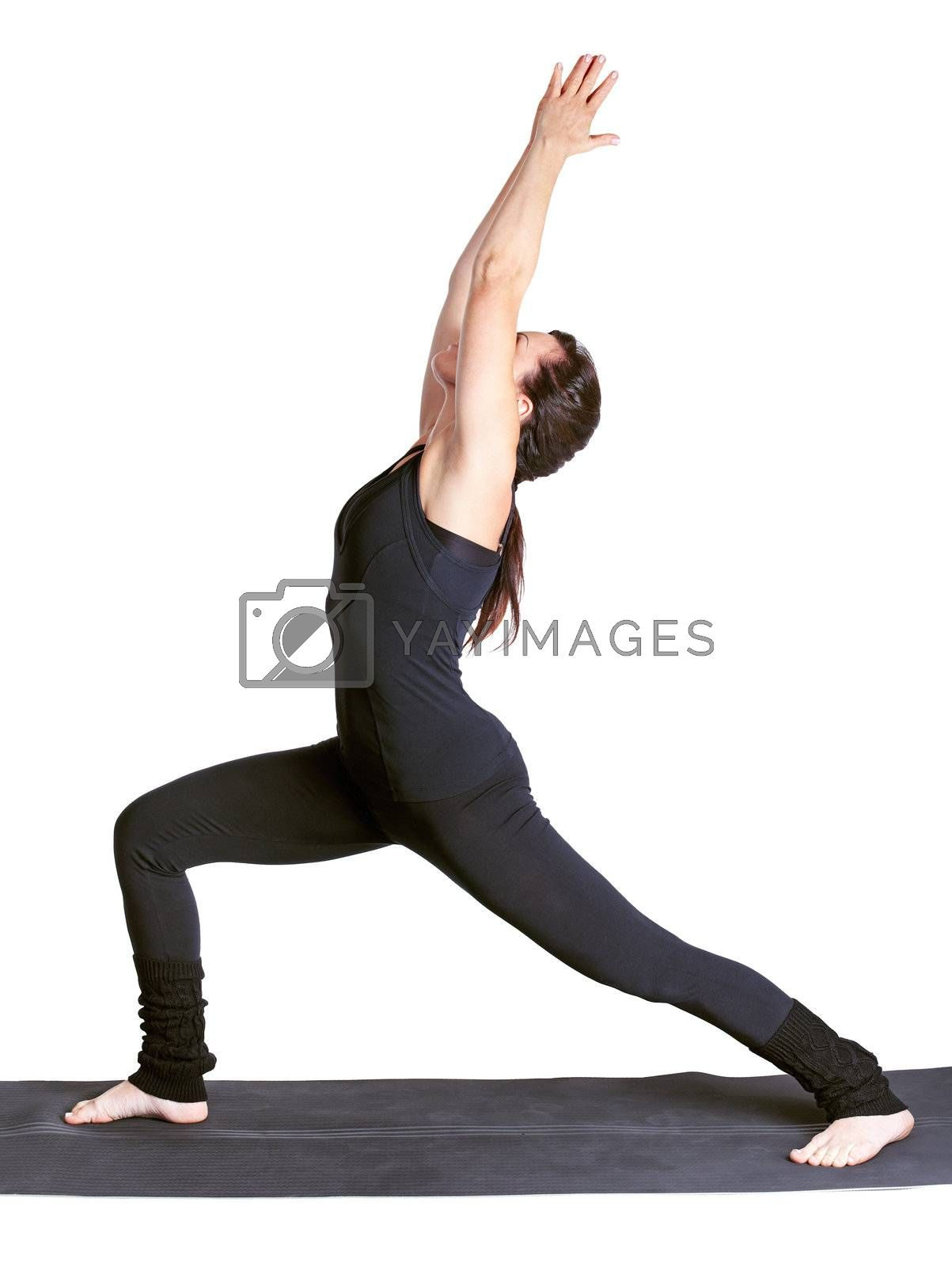 full-length portrait of beautiful woman working out yoga exercise crescent moon  virabhadrasana on fitness mat