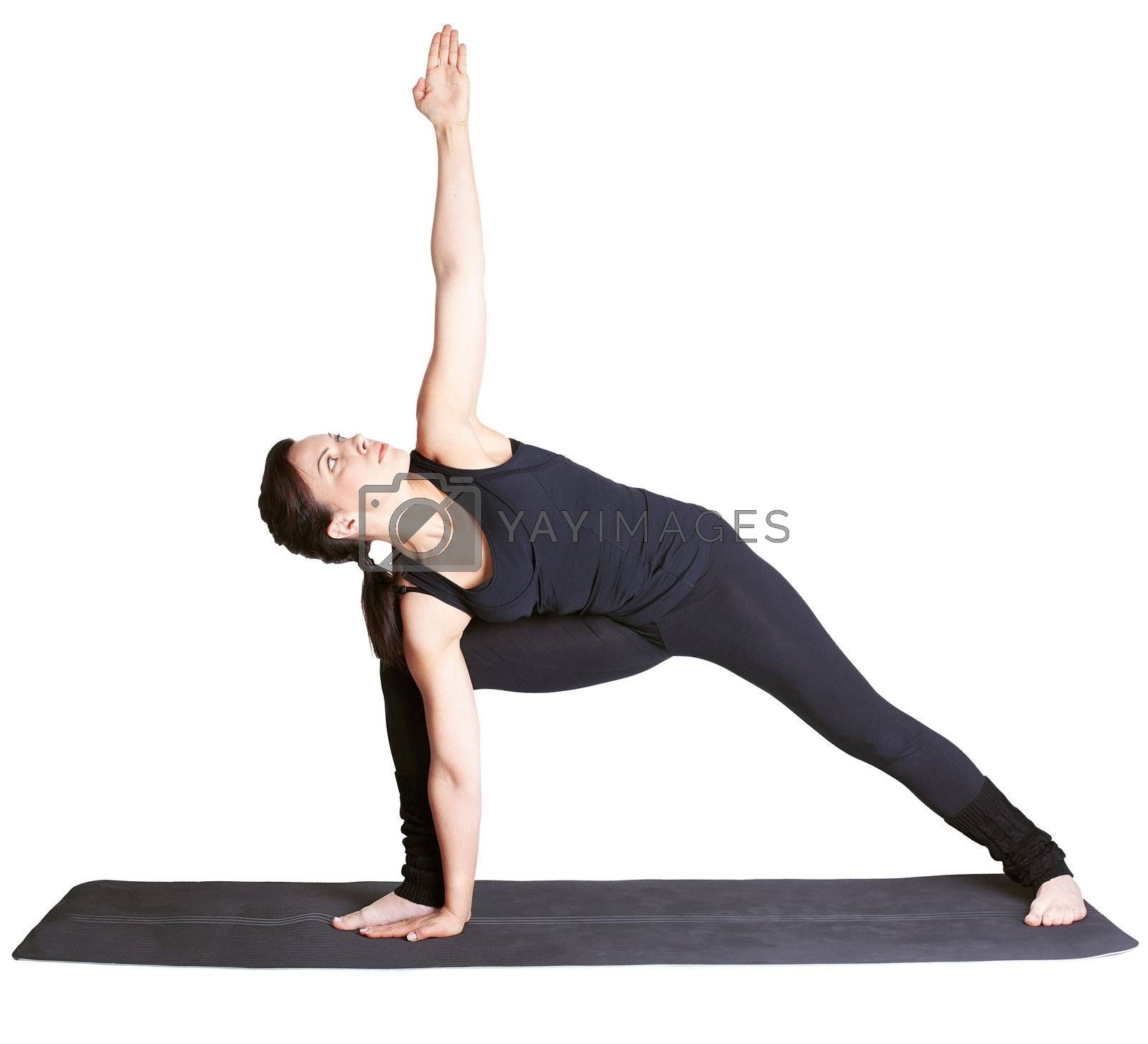 full-length portrait of beautiful woman working out yoga exercise side angle pose on fitness mat