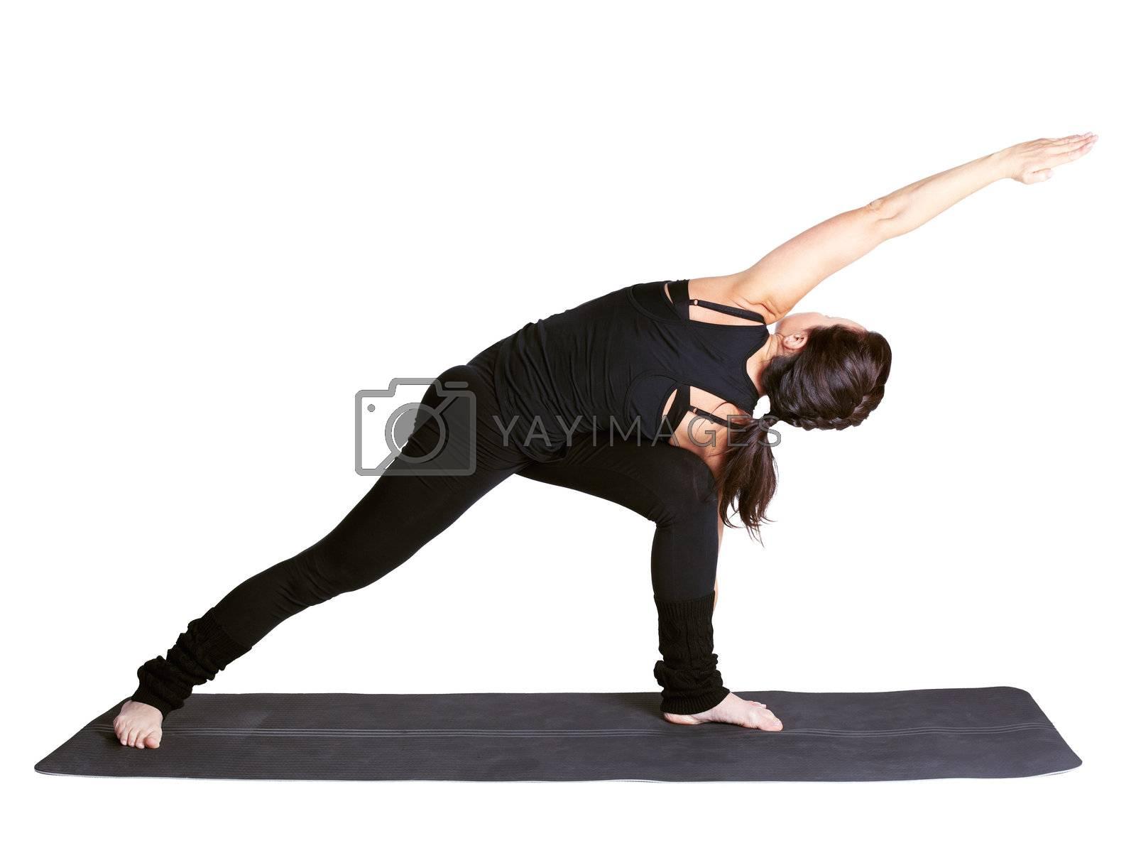 full-length portrait of beautiful woman working out yoga exercise reverted side angle pose utthita parshvakonasana on fitness mat