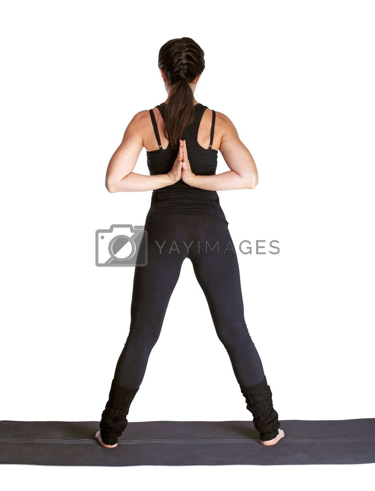 full-length portrait of beautiful woman working out yoga exercises namaste for parshvottanasana on fitness mat