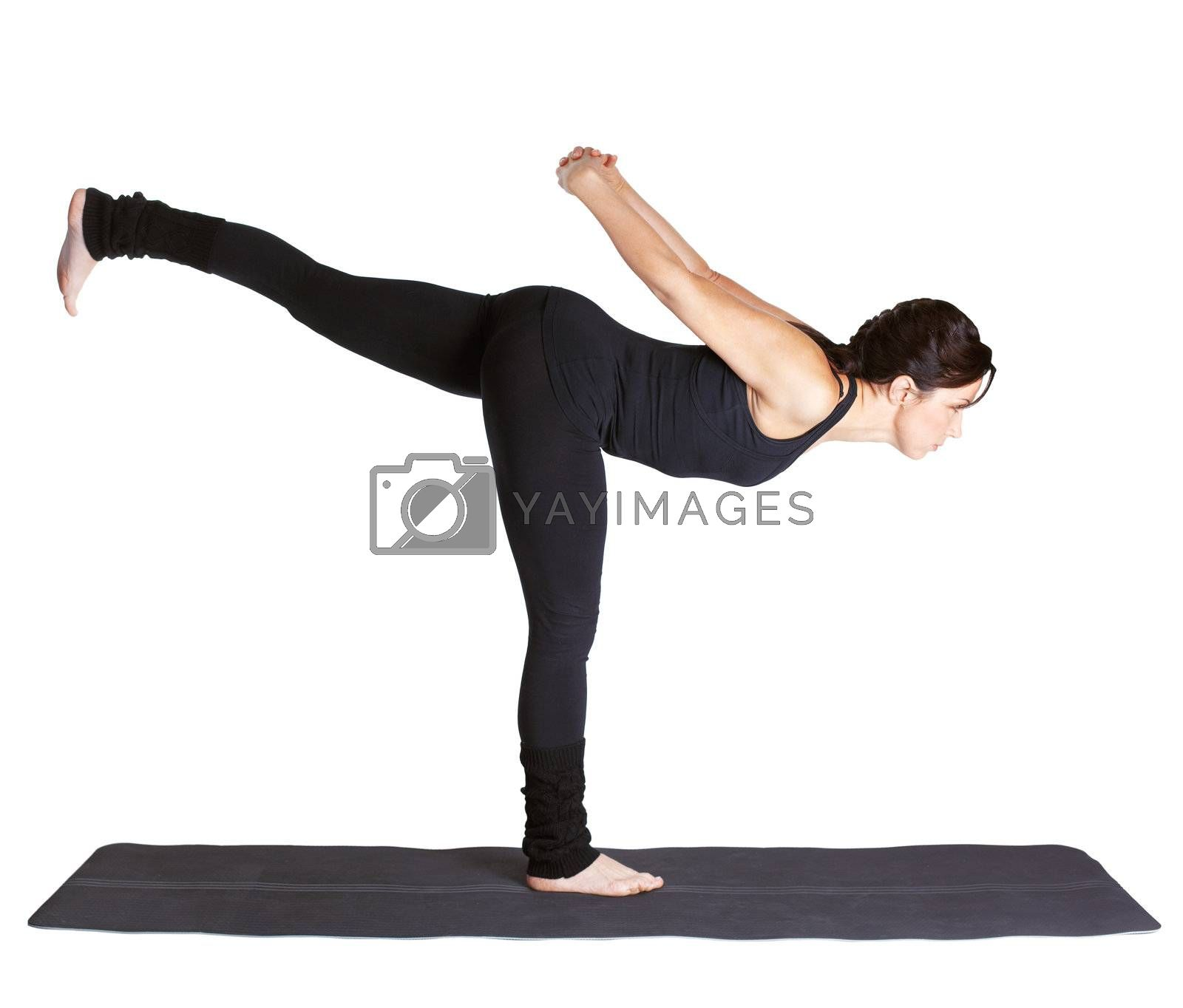 full-length portrait of beautiful woman working out yoga exercise Virabhadrasana III on fitness mat