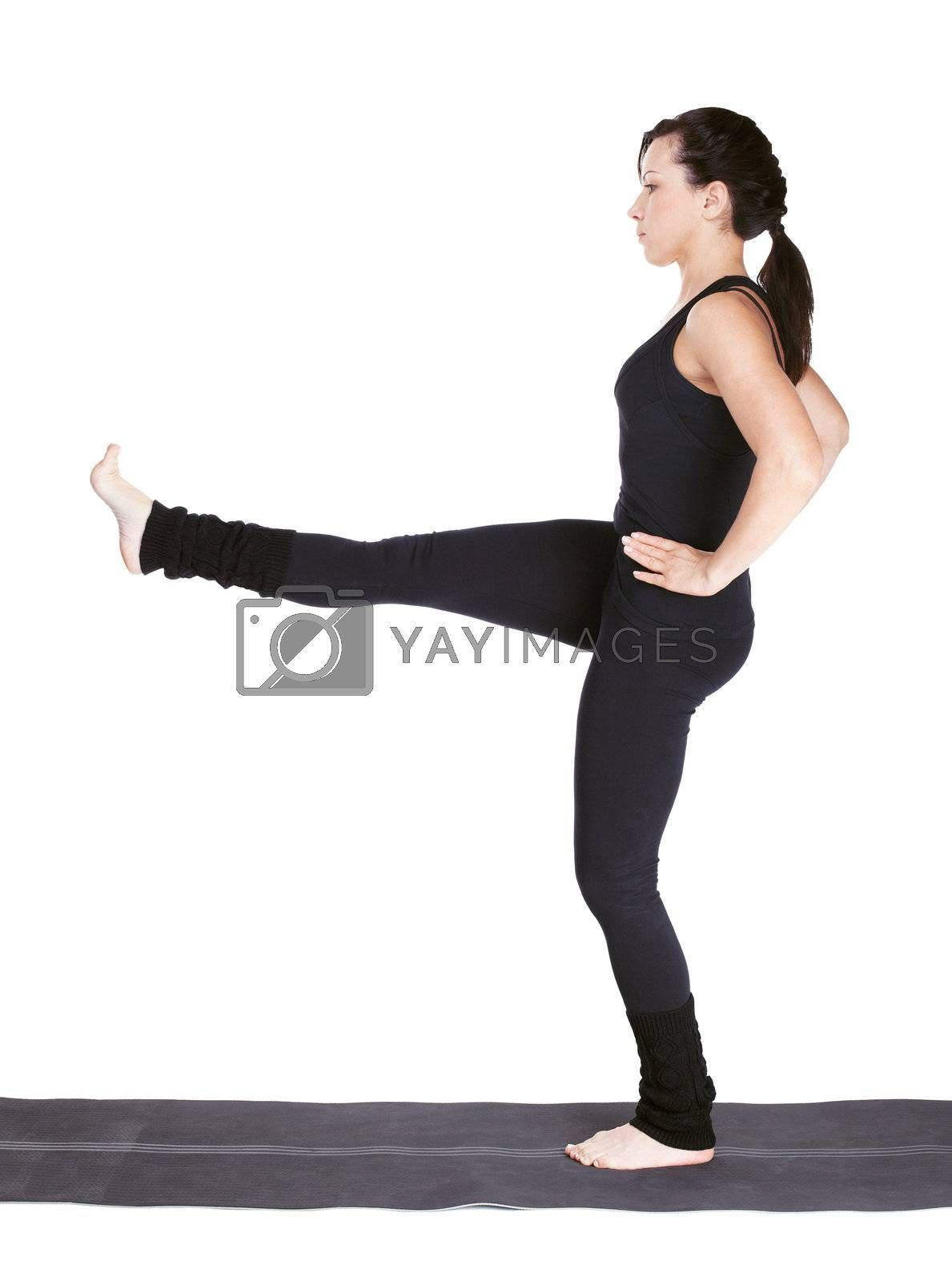 full-length portrait of beautiful woman working out yoga exercise utthita Parsva Sahitya on fitness mat