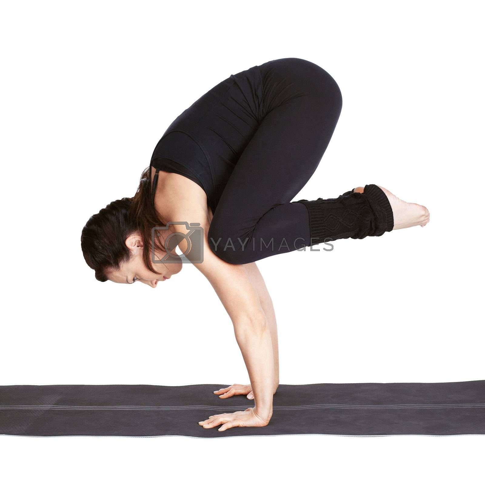 full-length portrait of beautiful woman working out yoga exercise bakasana (crane pose) on fitness mat