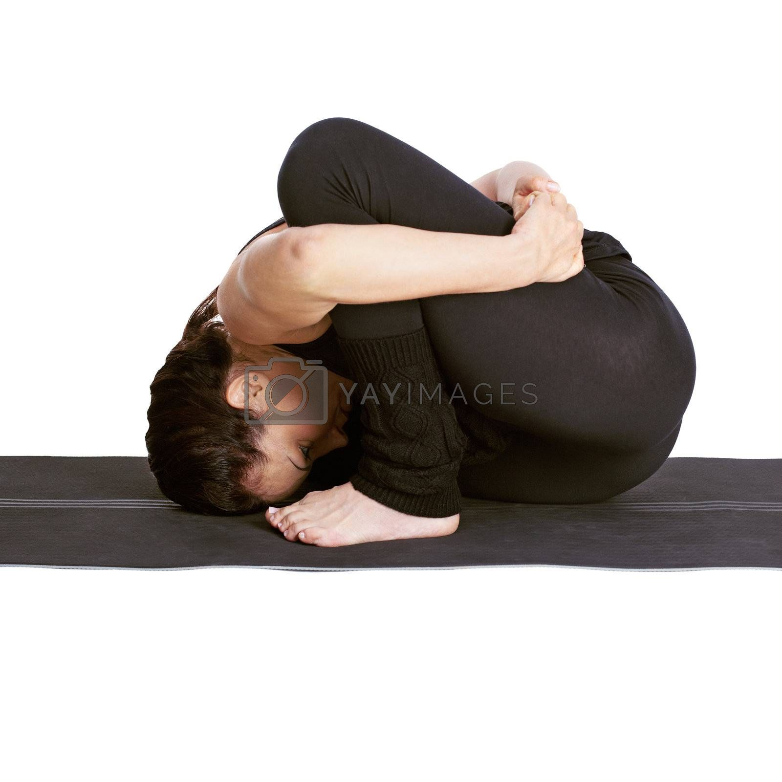 full-length portrait of beautiful woman working out yoga exercises marichiasana on fitness mat